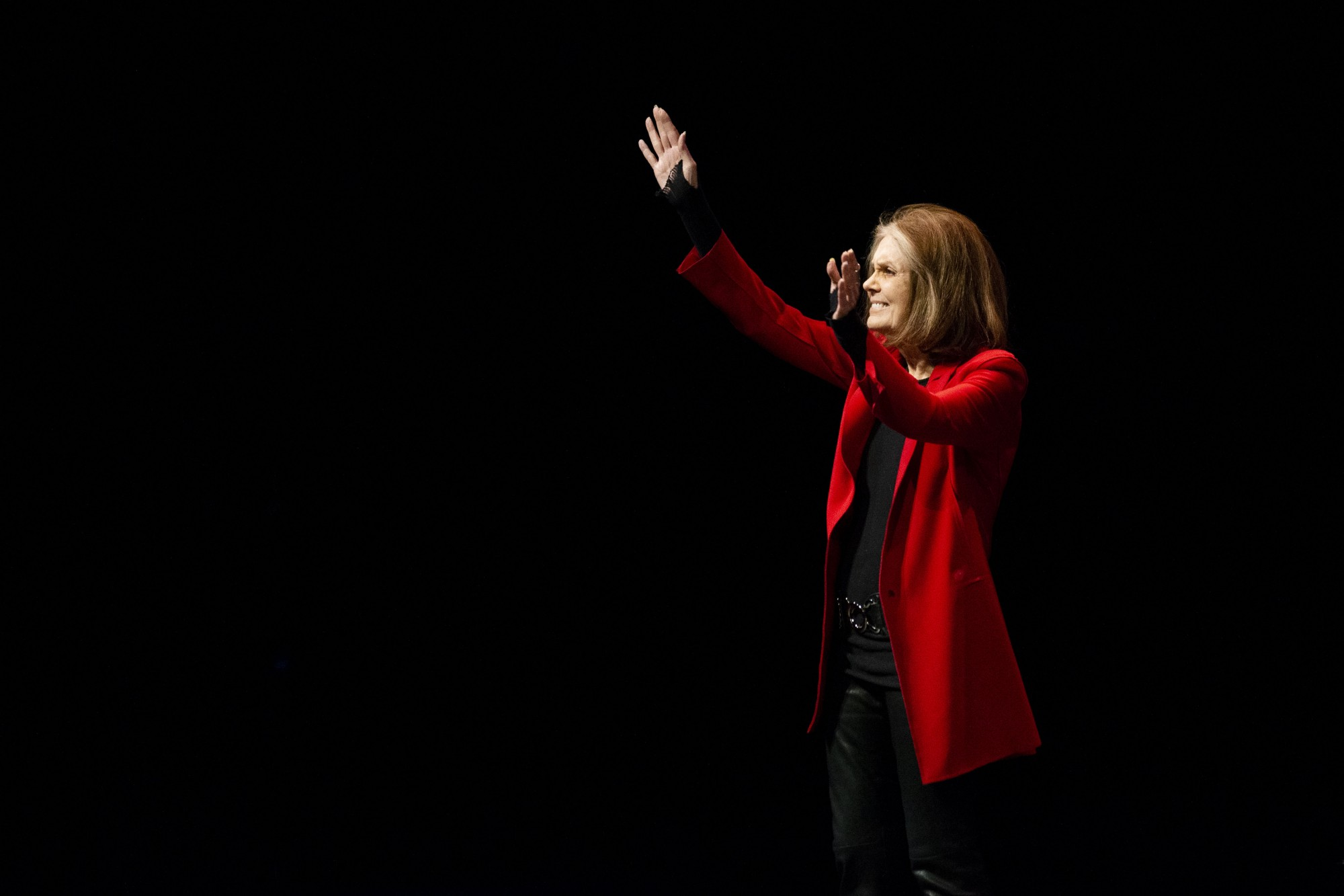 <p>Writer, political activist and feminist organizer Gloria Steinem walks onstage for a moderated discussion at Northrup Auditorium on Wednesday, Feb. 20.</p>
