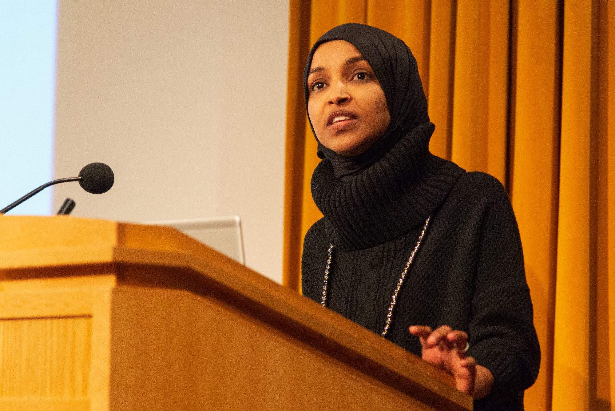 "Rep. Ilhan Omar addresses an audience in Cowles Auditorium on Tuesday, Feb. 18. The event centered around her ""Pathway to Peace,"" a package of seven bills which aim to reorient U.S. foreign policy."
