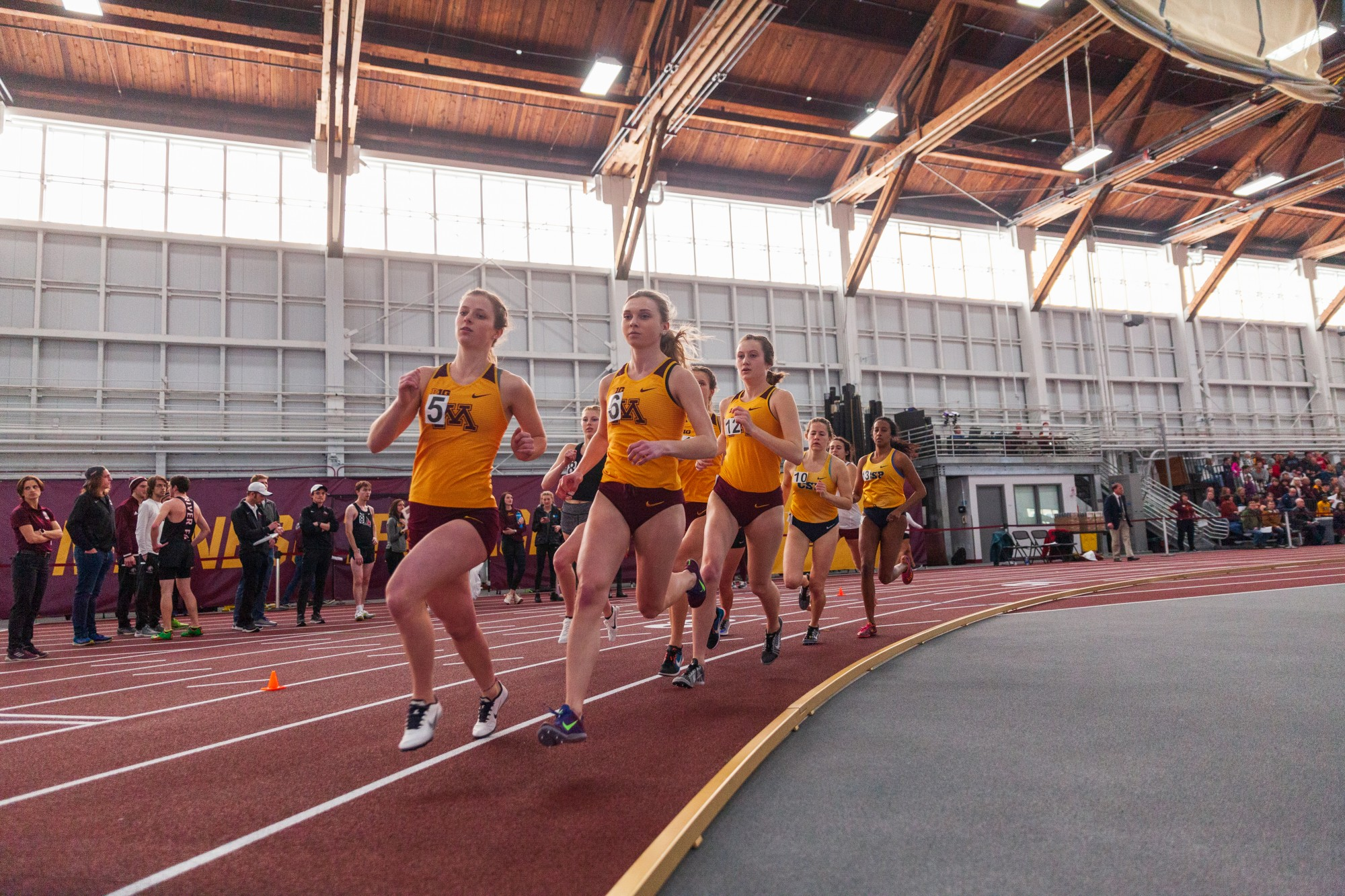 Gophers women lead the field in the mile run at the Minnesota Cold Classic at the University of Minnesota Fieldhouse on Friday, Feb. 21.