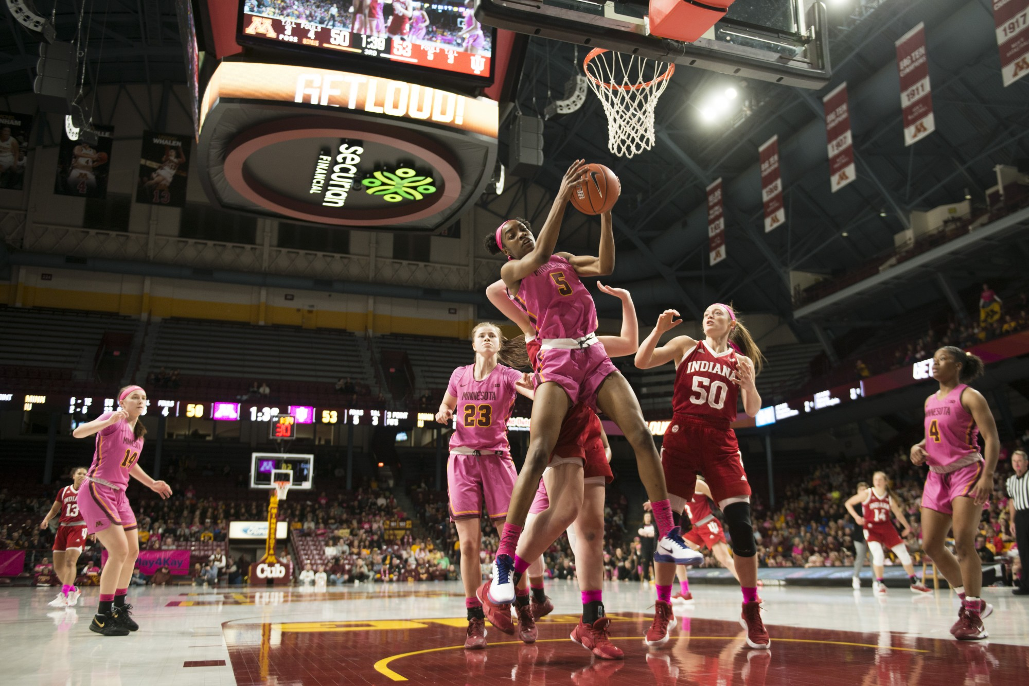 Forward Taiye Bello secures a rebound near the end of the fourth quarter during the Gophers' 75-69 loss to Indiana at Williams Arena on Saturday, Feb. 22.