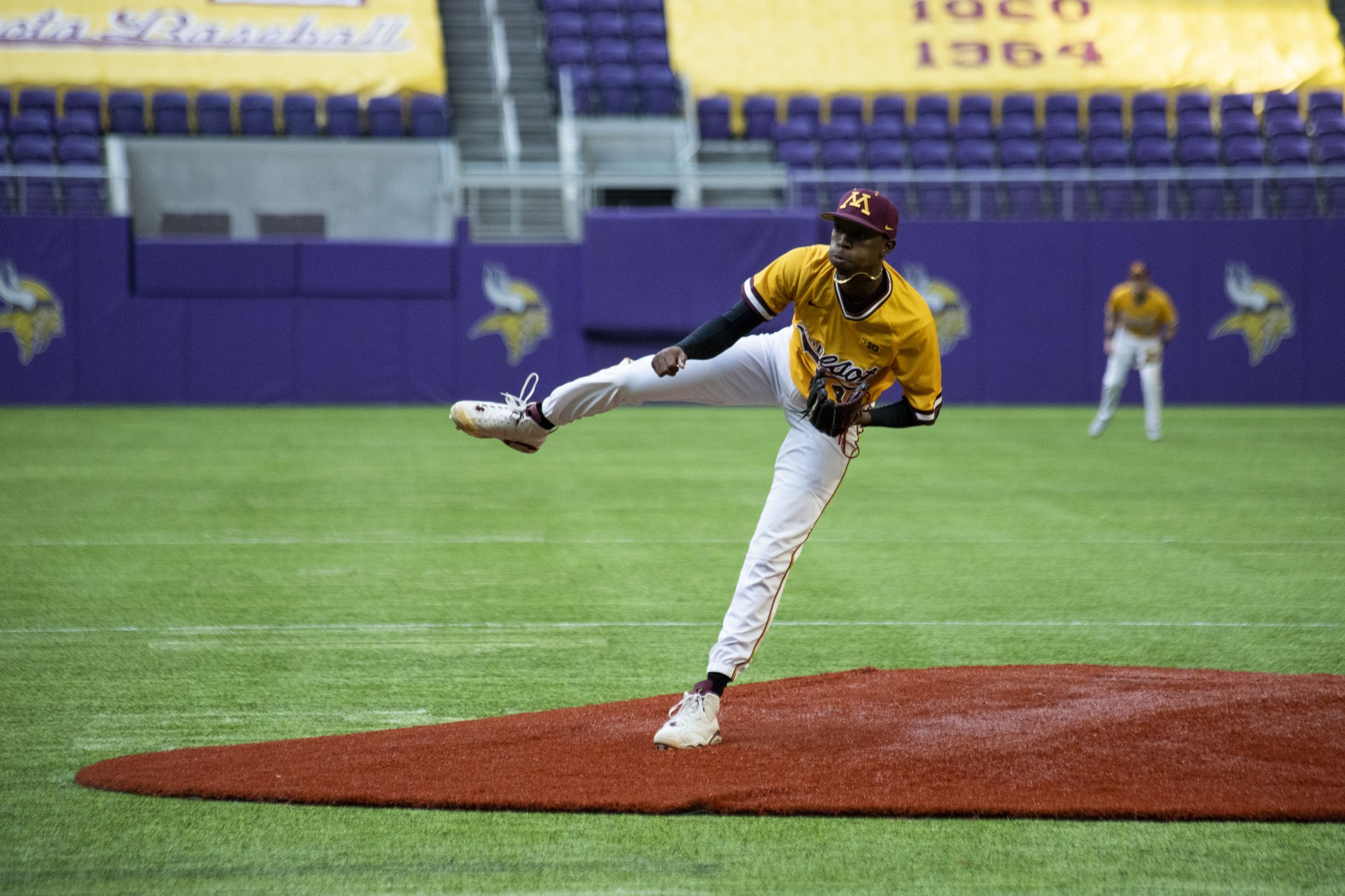 Pitcher J.P. Massey pitches the ball during the Gophers' 7-6 win against Texas Christian University at U.S. Bank Stadium on Saturday, Feb. 23.