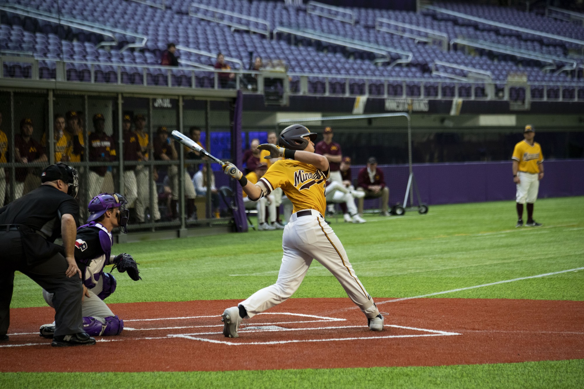 Infielder Jack Wassel swings at bat during the Gophers' 7-6 win against Texas Christian University at U.S. Bank Stadium on Saturday, Feb. 23.
