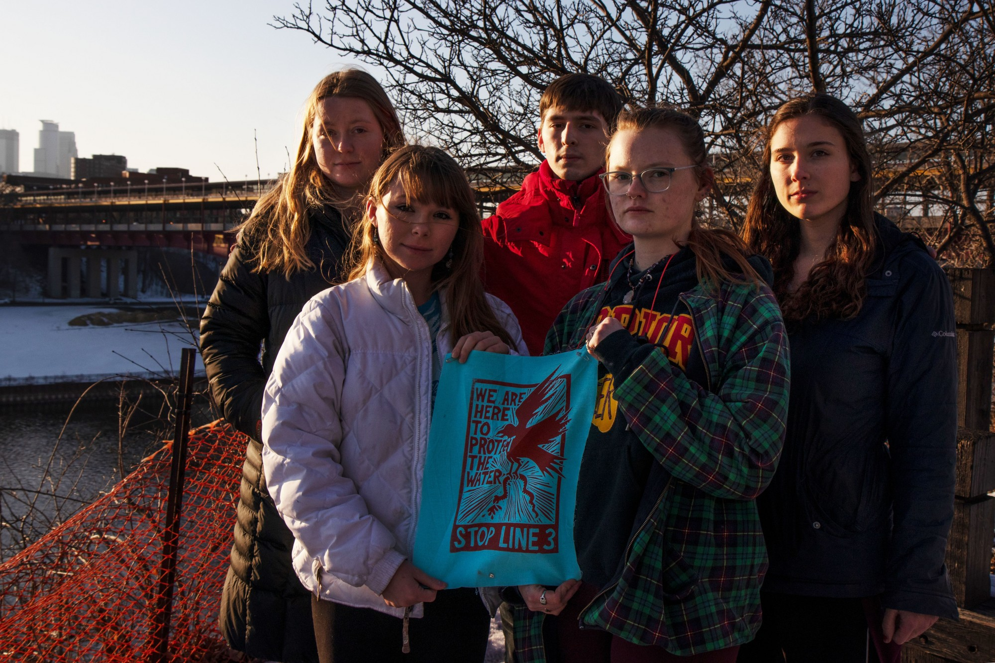 """From left, Grace Hogan, Madeline Miller, Benjamin Perez, Elizabeth Zanmiller and Sally Zuzuly, officers of the new """"Students Against Pilelines"""" student group, pose for a group portrait by the Mississippi river on Friday, Feb. 21. Miller says that issues around pipeline construction, including Line 3, affect students on campus as well as the rest of the state."""