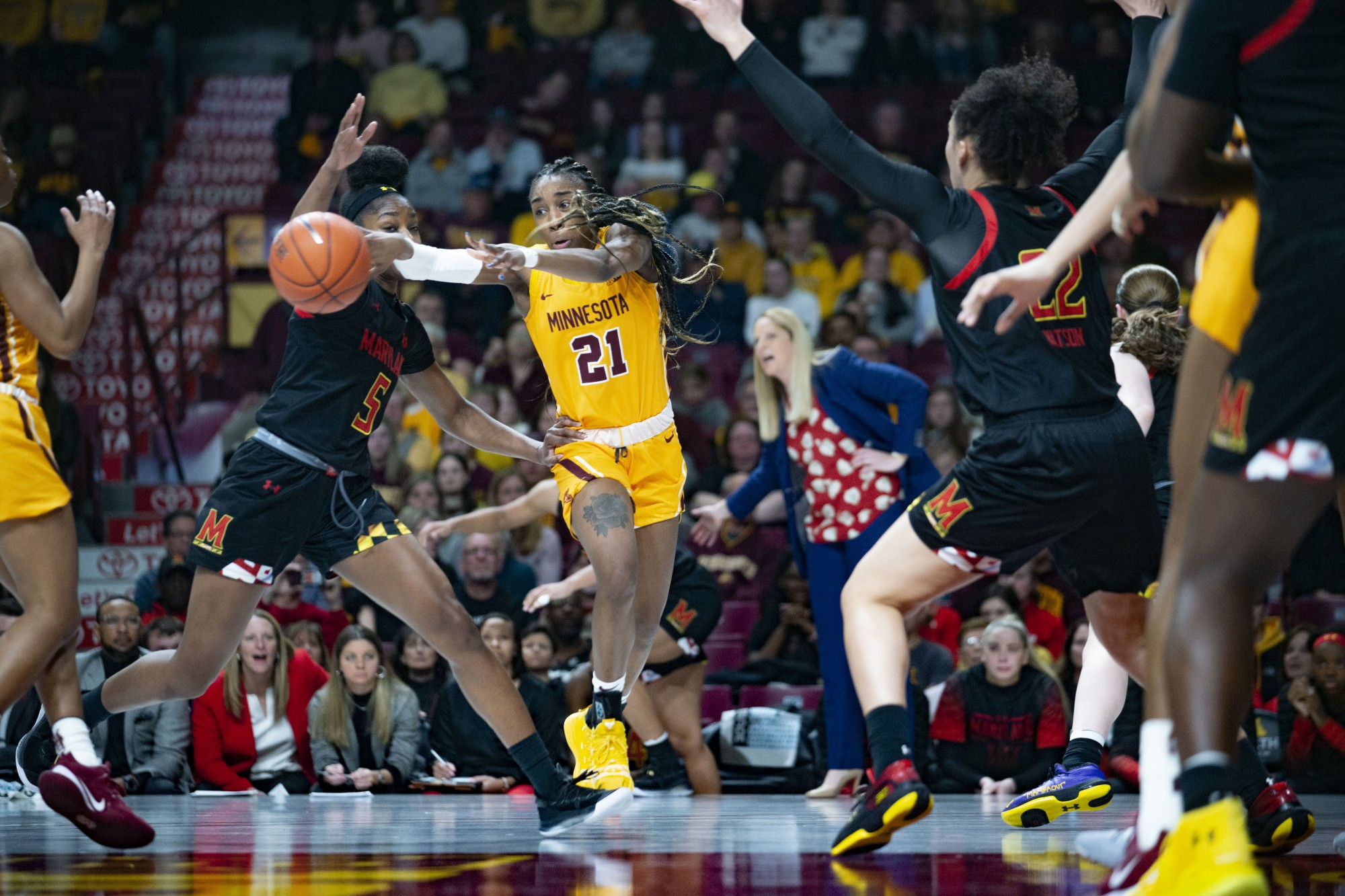 Guard Jasmine Brunson passes the ball through defenders at Williams Arena on Sunday, March 1. The Gophers fell to Maryland 99-44.