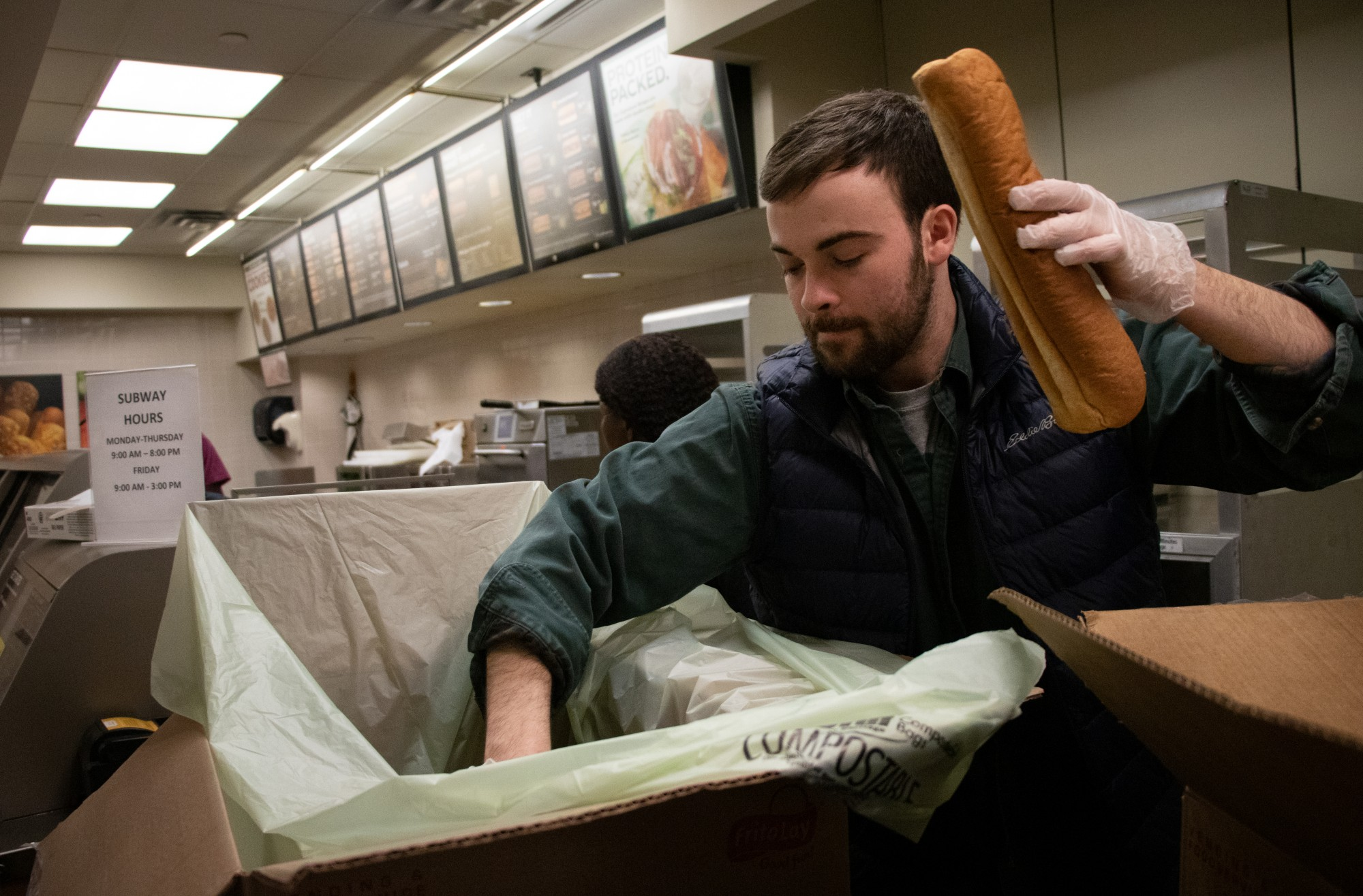 Will Bergstrom collects unused food from the Blegen Hall Subway on Friday, Feb. 28. Every Friday, the Subway location donates their unused food that would otherwise be thrown away.