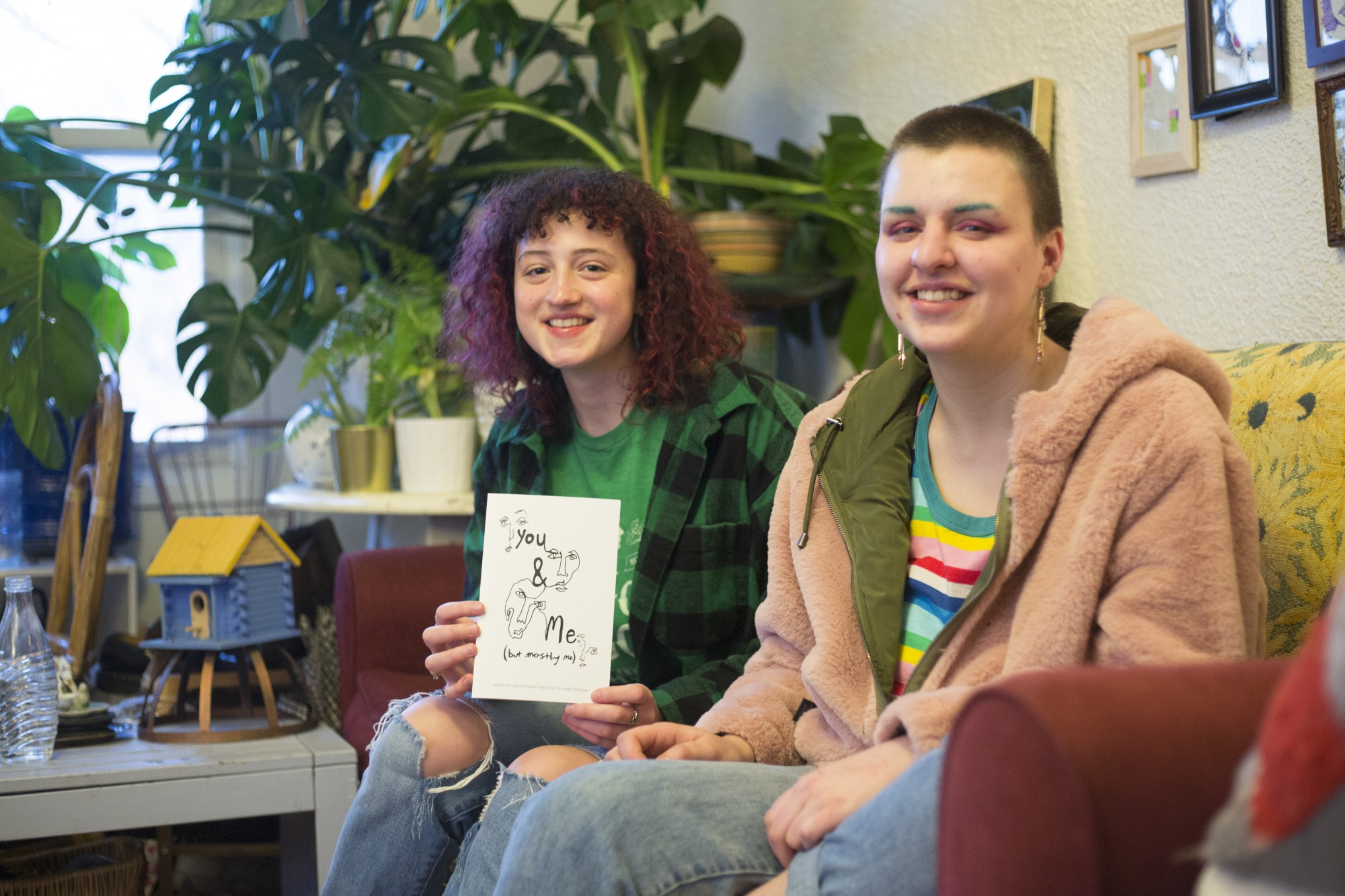 Writer Olivia Baxter, left, and Artist Cedar Thomas pose with their newly published book of poems entitled You and Me (But Mostly Me). The book features poetry by Baxter coupled with illustrations by Thomas.