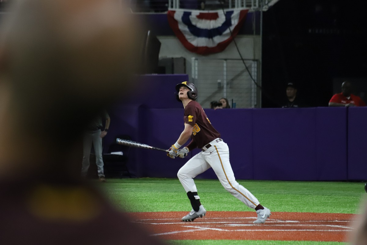 Gophers infielder Jack Wassel watches the ball after a hit at U.S. Bank Stadium on Saturday, Feb. 29, 2020. The Gophers fell to Duke 3-7.