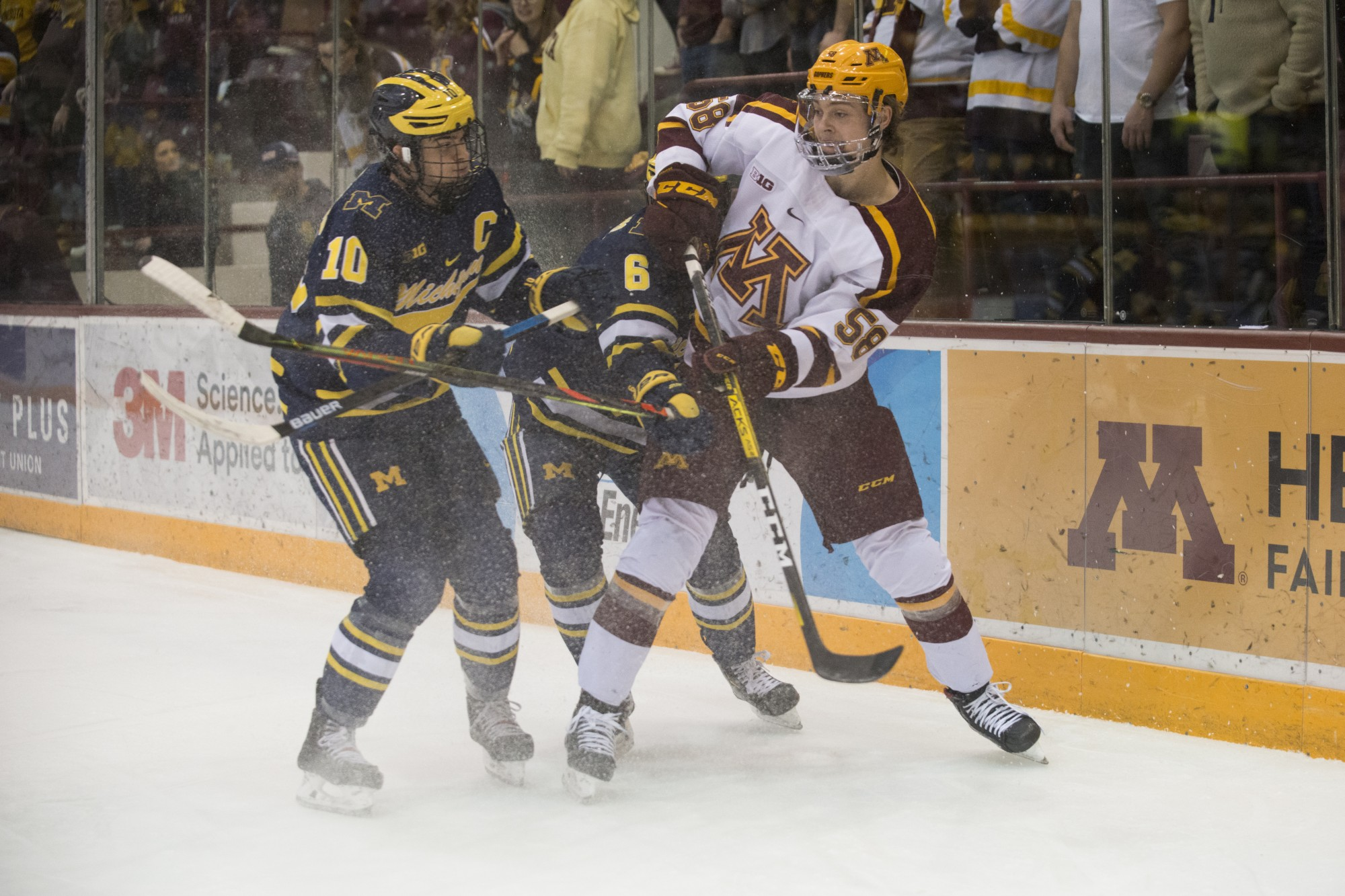 Gophers Forward Sampo Ranta battles a defender at the 3M Arena at Mariucci on Friday, Feb. 28. The Gophers lost to Michigan 3-2.