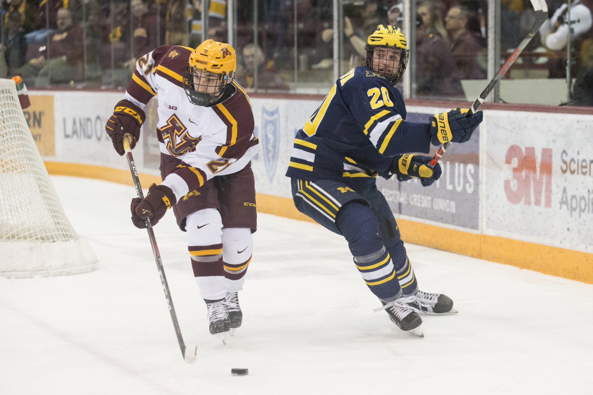 Gophers Forward Nathan Burke lines up a pass at the 3M Arena at Mariucci on Friday, Feb. 28. The Gophers lost to Michigan 3-2.