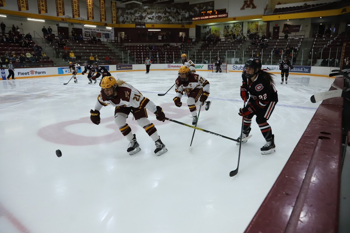 Gophers Forward Emily Oden chases after the puck at Ridder Arena on Friday, Feb. 28. The Gophers scored two power-play goals on the way to a 4-2 victory over St. Cloud State.