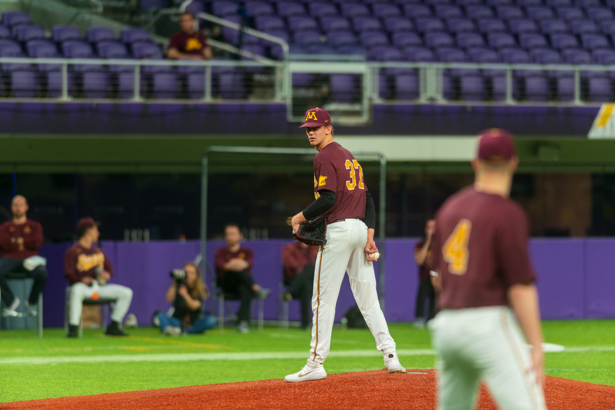Gophers Pitcher Trent Schoeberl scans the field at U.S. Bank Stadium on Tuesday, March 3.