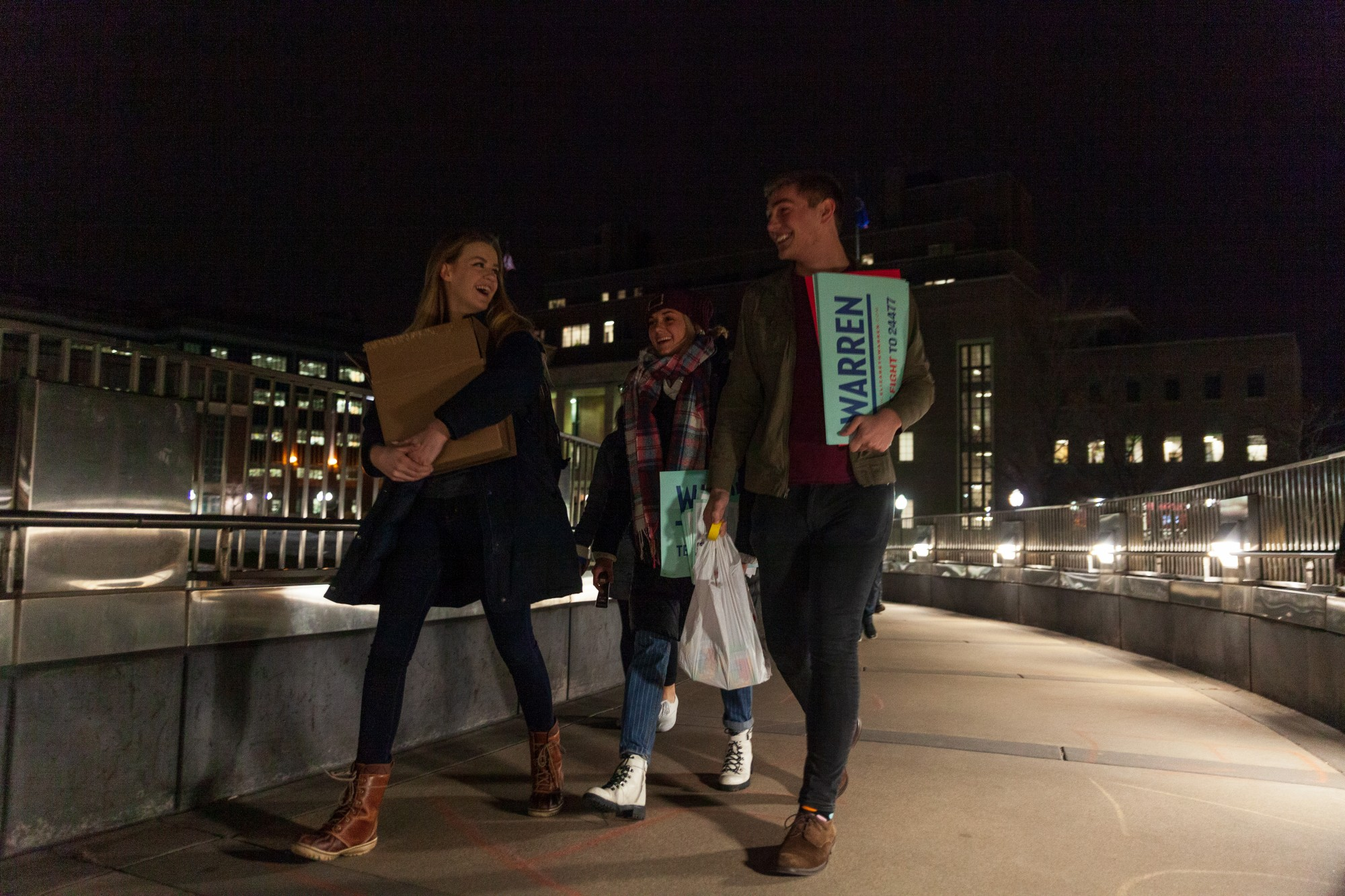 Student supporters of Democratic presidential candidate Sen. Elizabeth Warren gather on the East Bank to chalk and poster areas of the campus before Super Tuesday on Monday, March 2.