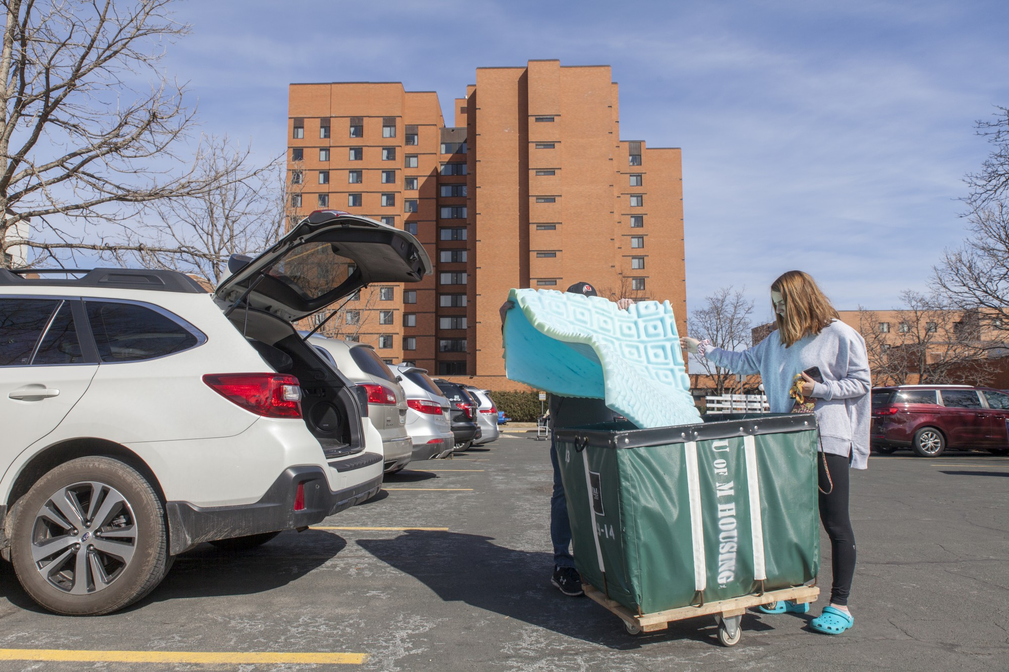 Freshman Marissa Mazzetta loads her belongings in preparation for her return to Illinois with her father, Jim Mazzetta, at Middlebrook Hall on Saturday, March 21. Mazzetta, like many freshmen at the University of Minnesota, is moving out of University housing as a result of COVID-19.