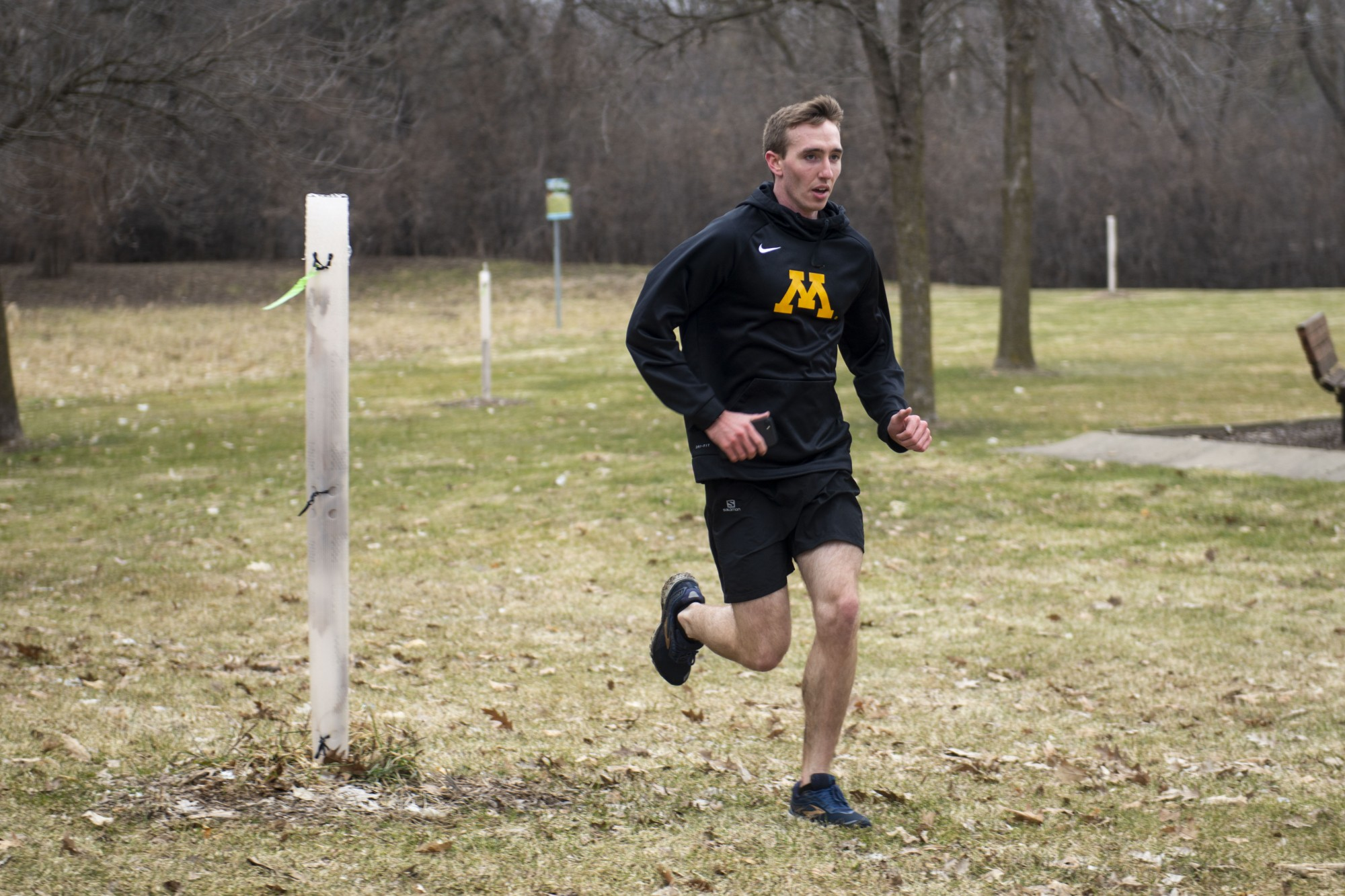 """Sophomore Austin Morrow completes the last lap of his run at Hidden Ponds Park in Eden Prairie on Saturday, March 28. """"Running is a big part of physical fitness,"""" he said."""