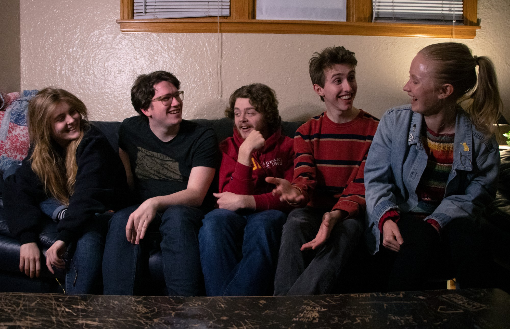 "From left, Izzy Bobby, Carter Ridl, Jacob Mechler, Henry Kueppers and coach Summer Freed of MN long form improv team ""Robot Family Band"" laugh while posing for a portrait before their team practice on Wednesday, March 4. The team won the Upper Midwest Regional Championship for long form improv, and is now advancing to nationals."