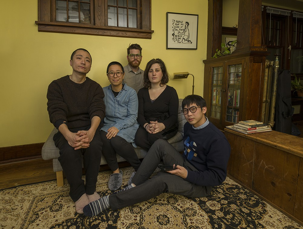CarryOn Homes Artists, from left, Peng Wu, Aki Shibata, Preston Drum, Zoe Cinel and Shun Jie Yong pose for a group portrait. CarryOn Homes creates art to tell the stories of immigrants and refugees in the USA.