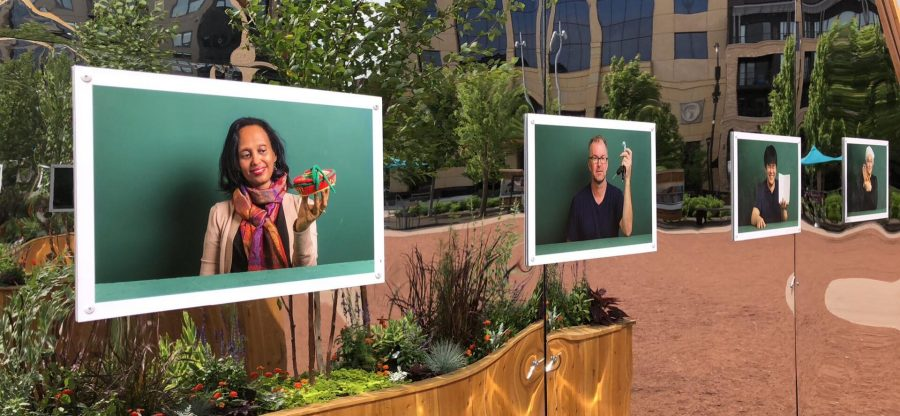 Portraits of new immigrants are displayed at CarryOn Homes at The Commons. Photos like these will be displayed in their next project which is planned for Central Ave in Northeast.