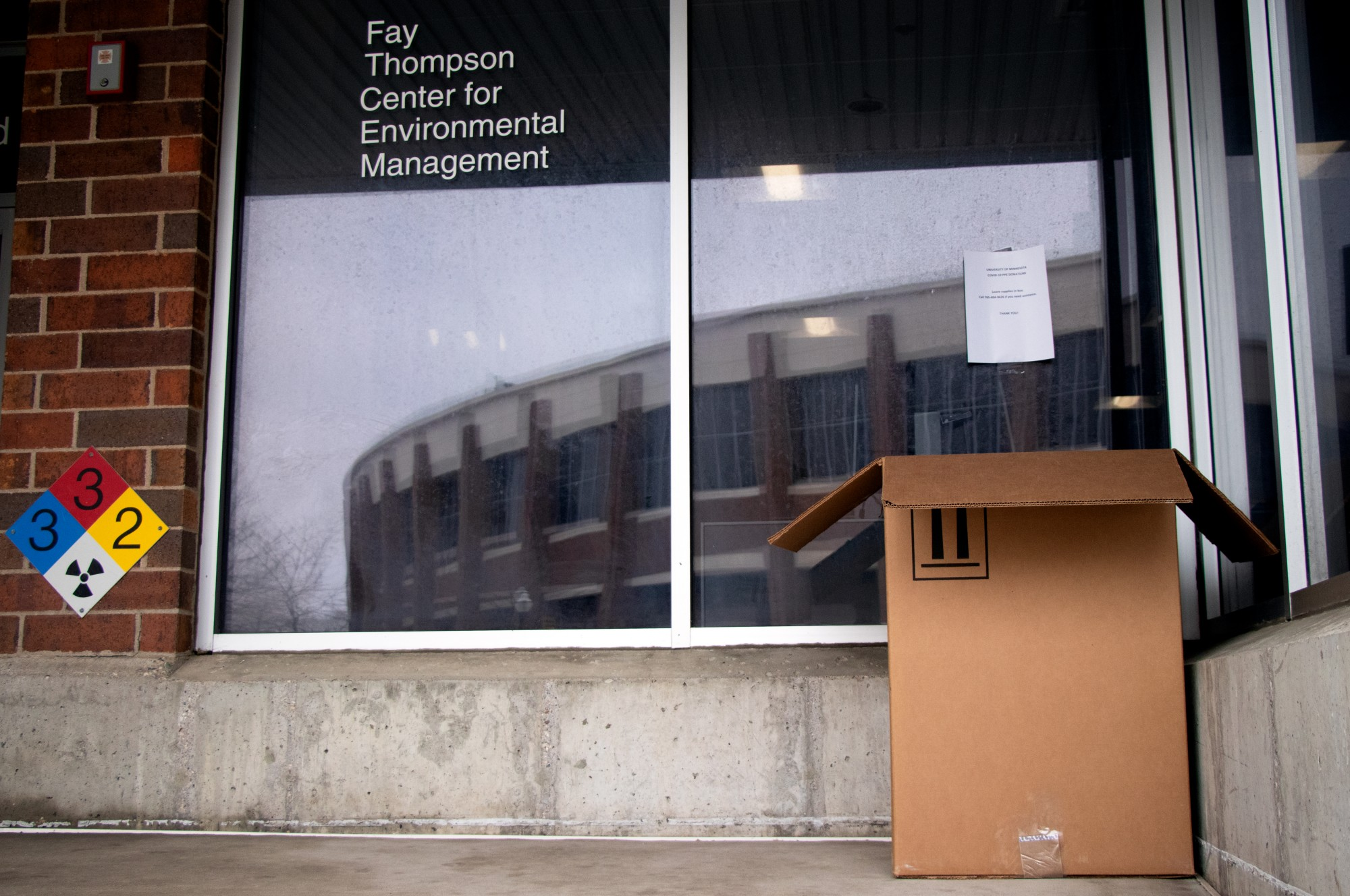 A community collection box for COVID-19 PPE donations sits outside of the Fay Thompson Center for Environmental Management on Tuesday, April 7. This collection is part of a larger campus effort to consolidate PPE and provide it to healthcare workers.