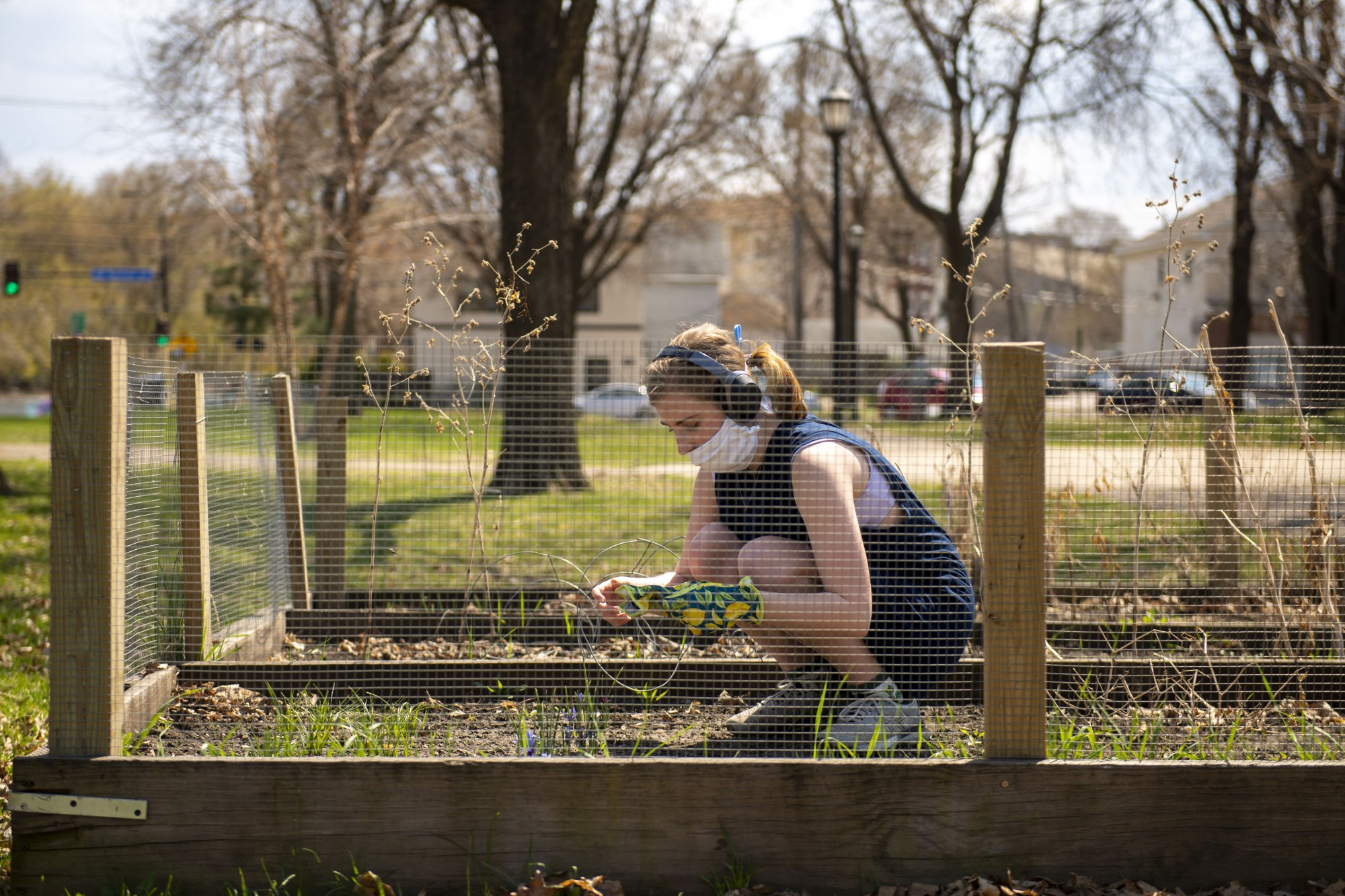 Sydney Murray works to improve a community garden located in Van Cleve Park in Minneapolis on Sunday, April 26.