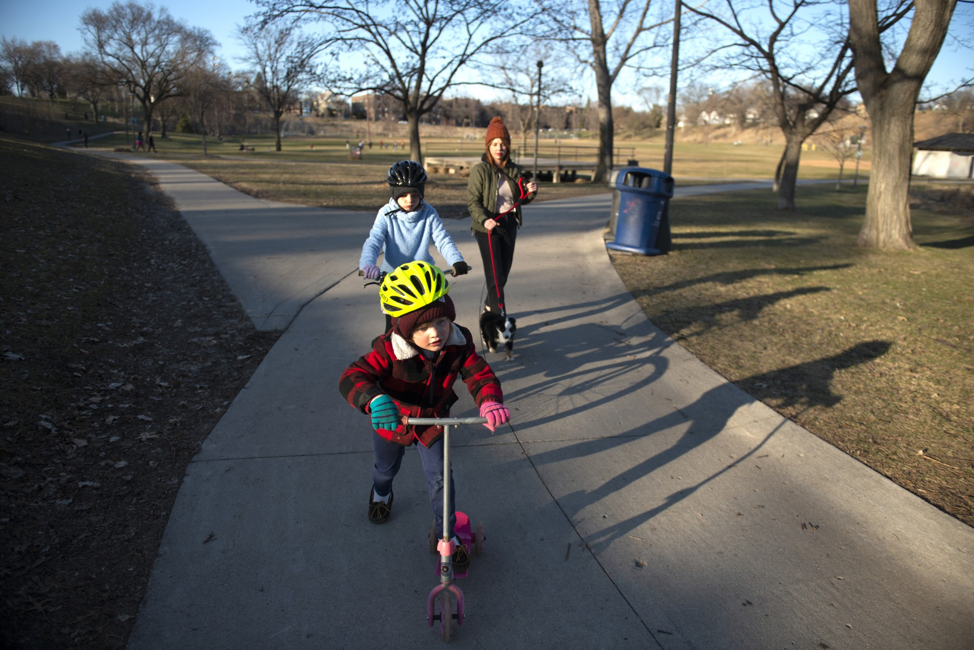 Nurse Johannah Bjorgaard takes her kids Islie (7) and Sullivan (4) to Powderhorn park in Minneapolis on Tuesday, March 31. They live nearby and frequent the park to help the kids get their energy out.