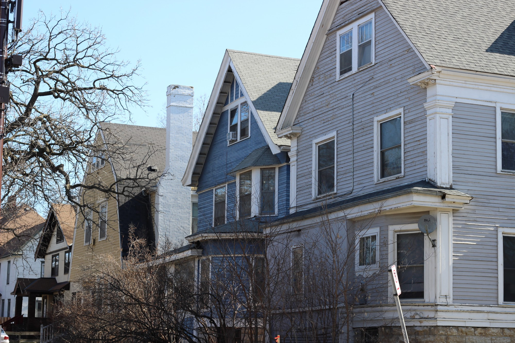 Three houses under consideration for demolition are seen in Marcy-Holmes on Sunday, April 5. The site could be host to a potential project with micro-unit apartments.