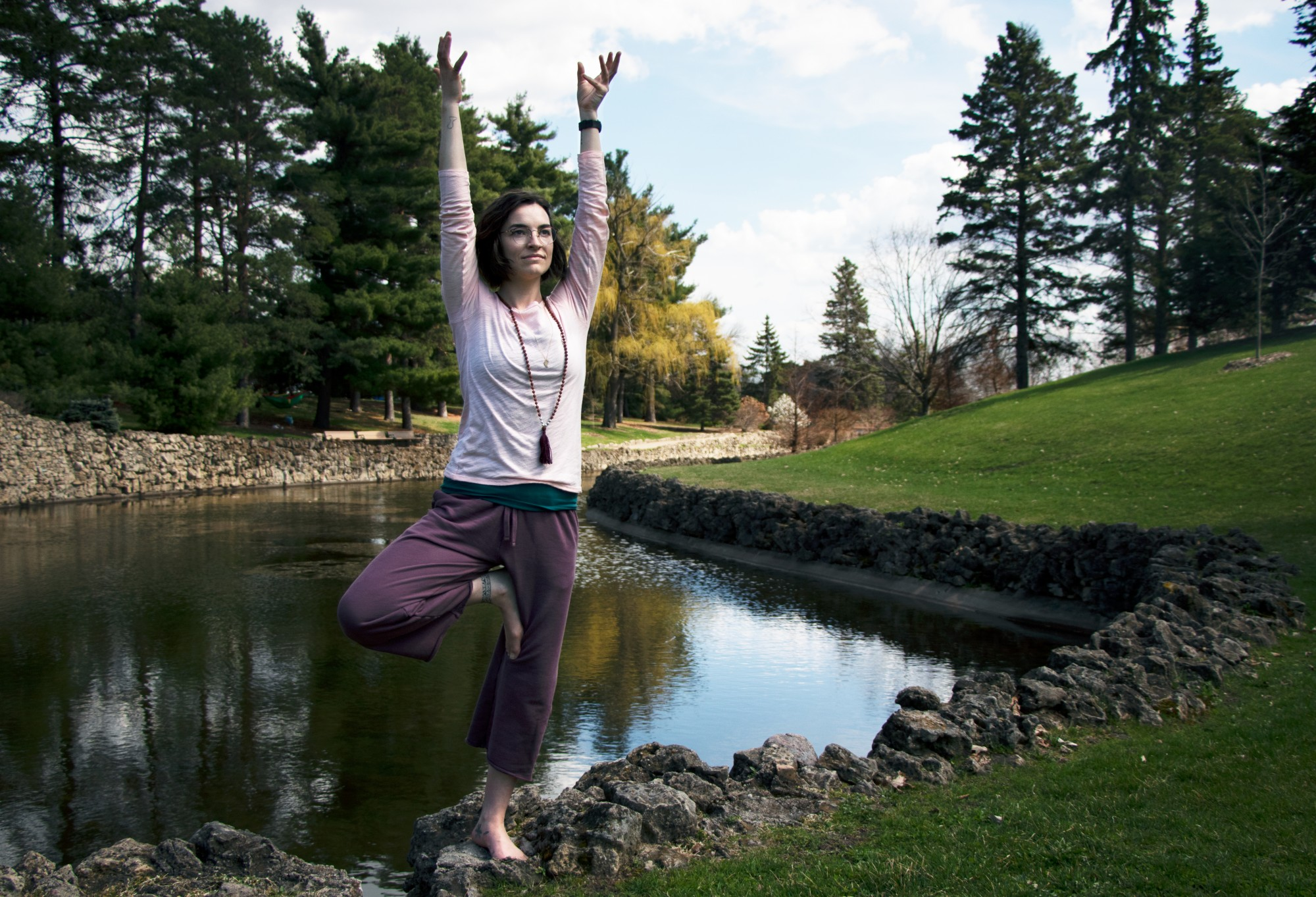 Tessa Jonson performs the Tree pose in Como Regional Park on Monday, April 27. Rose instructs both traditional yoga and meditation based classes online. In her teaching, Rose believes that the mental aspects of yoga are often more important than the physical.