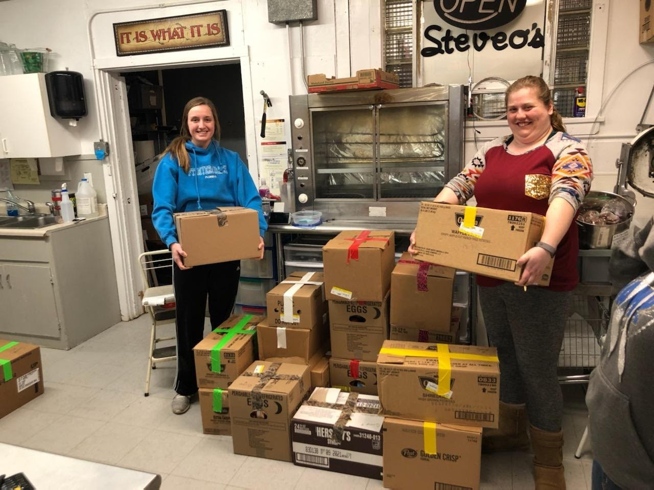 Volunteers pack color-coded meal kits at Bonnie's Hometown Grocery store.