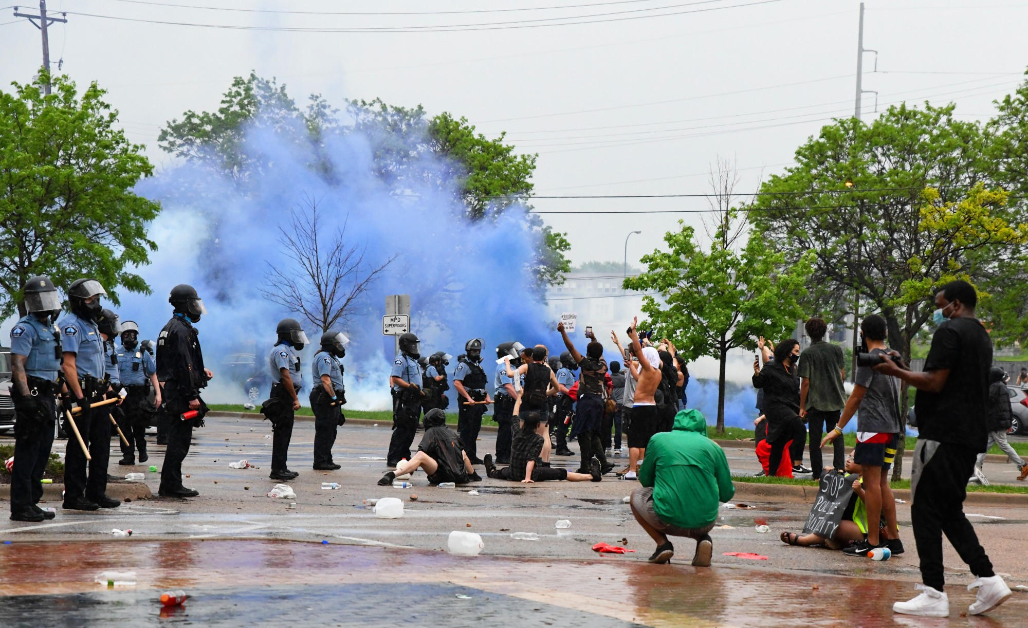 <p>Protesters clash with police outside of the Minneapolis 3rd Police Precinct on Minnehaha Avenue on Tuesday, May 26. The protest was in response to the death of George Floyd in police custody. </p>