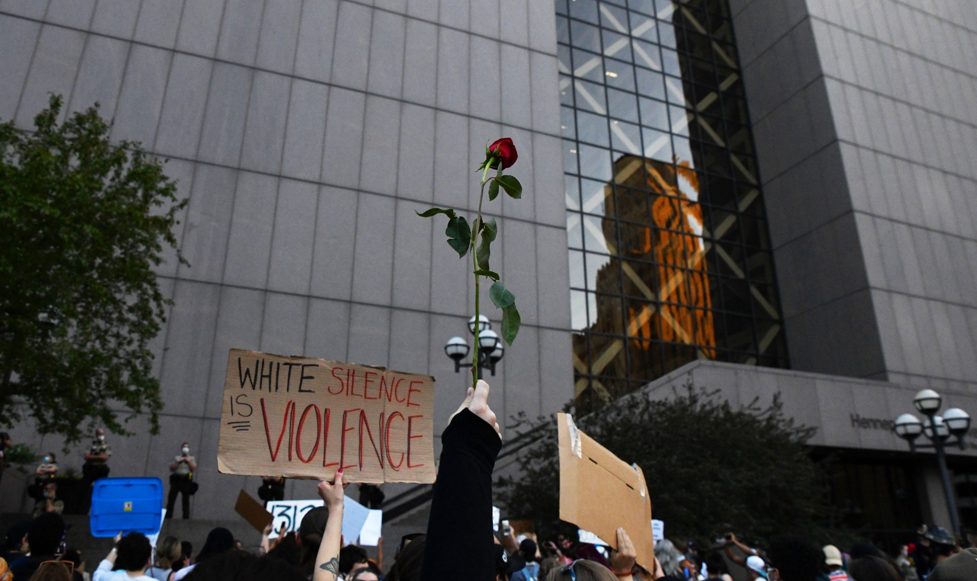 A demonstrator holds up a rose at the protest at Government Plaza in Minneapolis on Thursday, May 28.