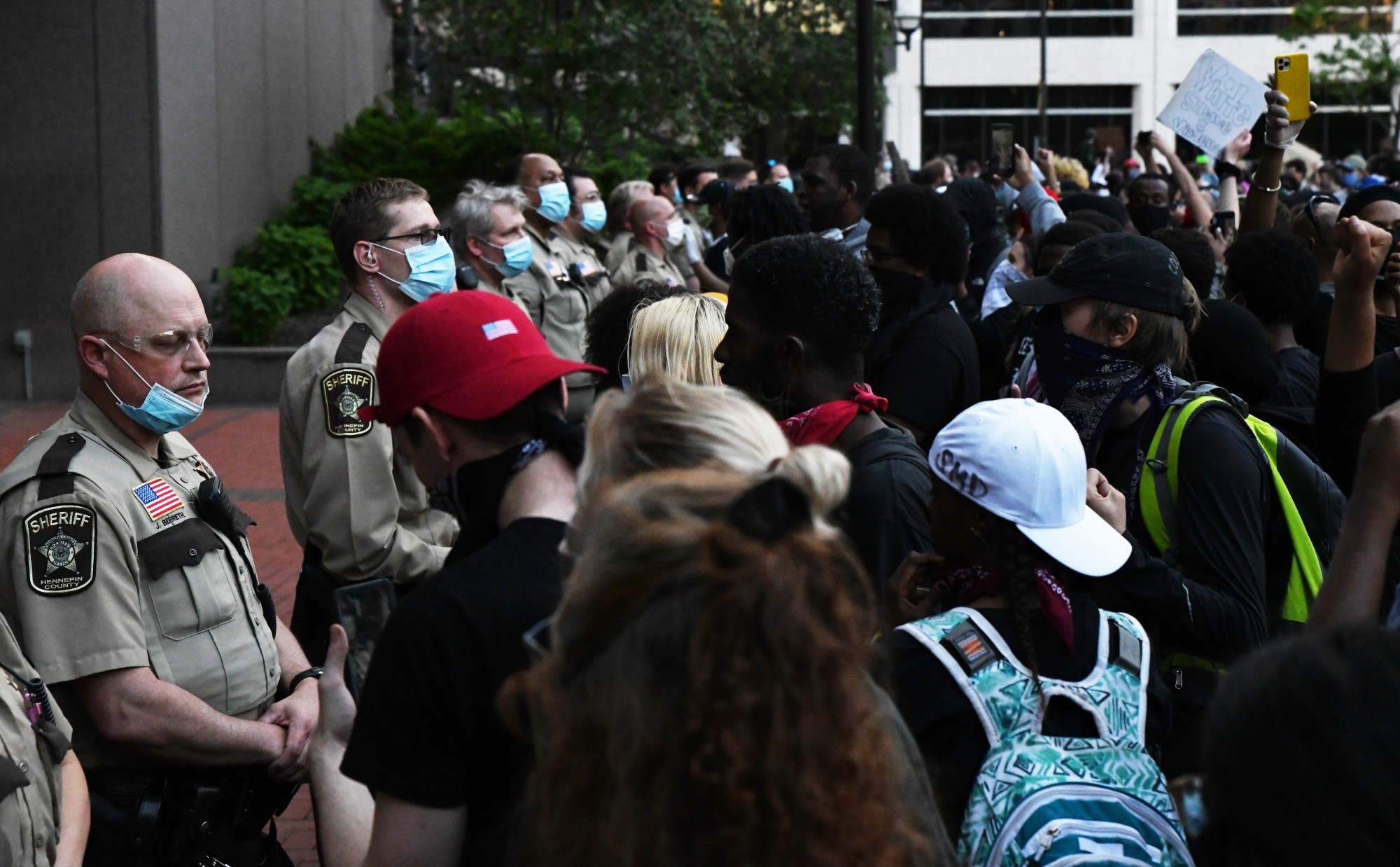 Hennepin County sheriffs face demonstrators in front of the Hennepin County Government Center in Minneapolis on Thursday, May 28.
