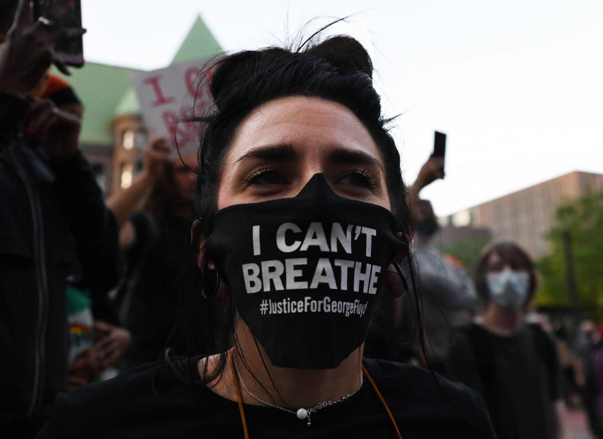 """Bree Reynolds wears a face mask that reads """"I Can't Breathe"""" at the protest in Government Plaza in Minneapolis on Thursday, May 28."""