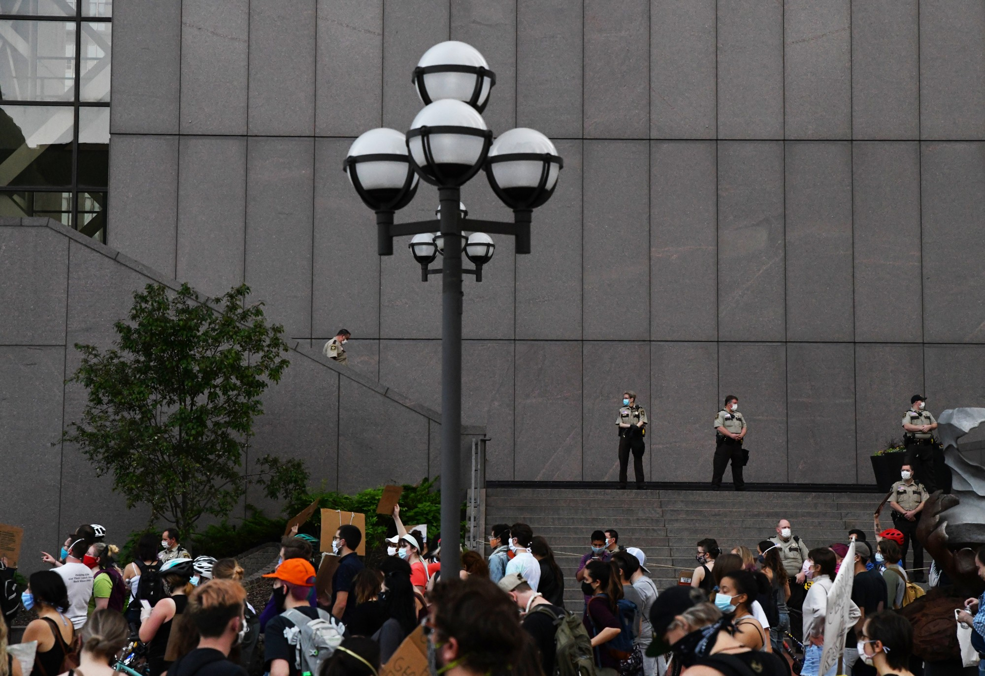 Hennepin County sheriffs overlook the crowd of protesters from the Hennepin County Government Center in Minneapolis on Thursday, May 28.