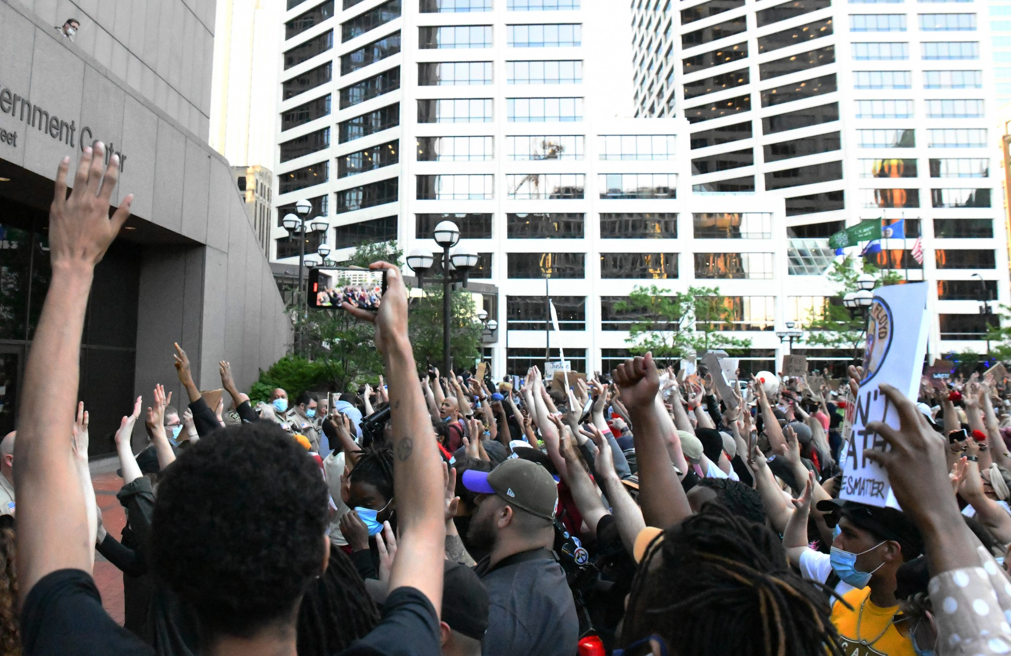 """Demonstrators chant """"Hands up, don't shoot"""" at the protest against police brutality in front of the Hennepin County Government Center in Minneapolis on Thursday, May 28."""