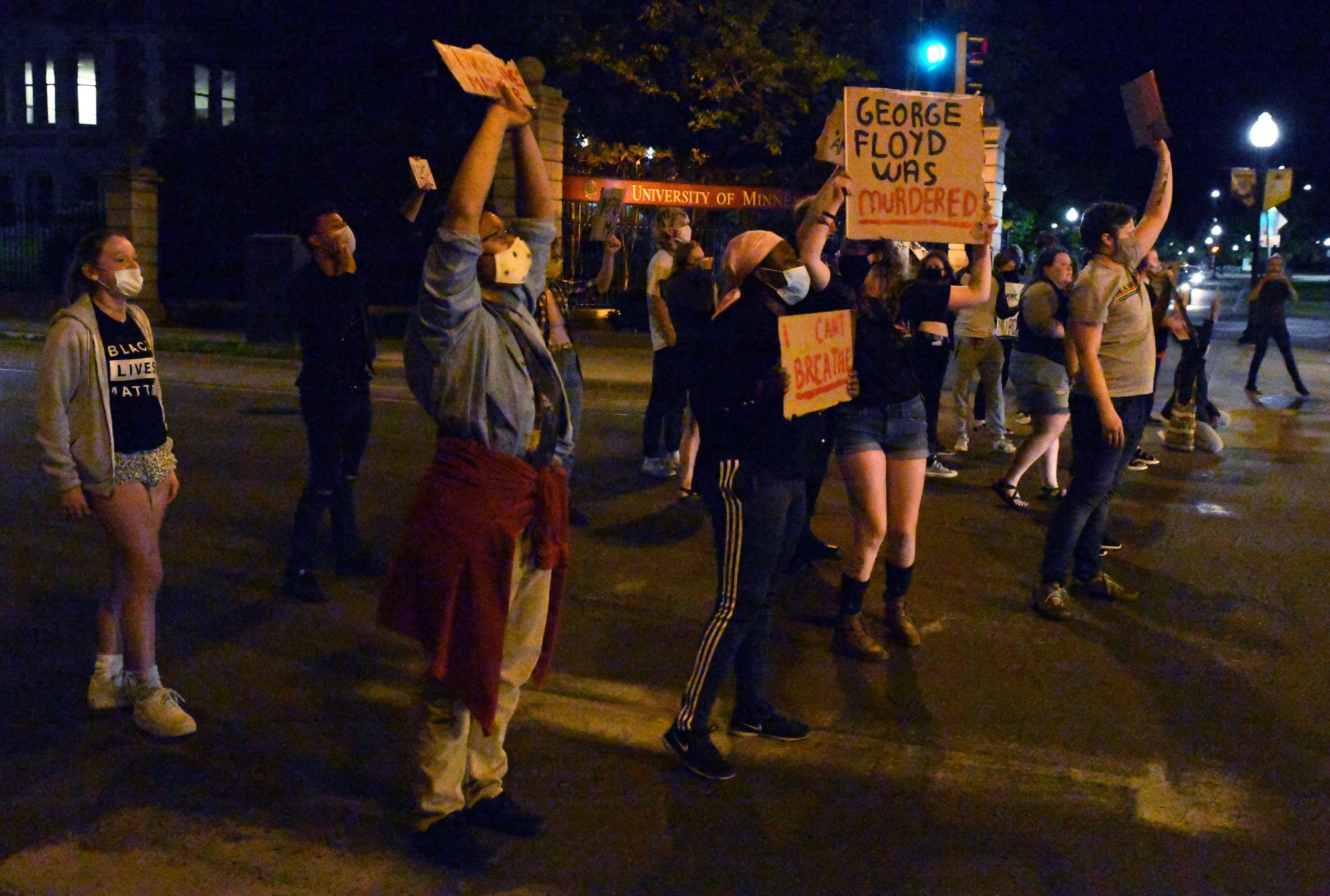 Students block the intersection of SE 15th Ave and SE University Ave in Dinkytown on Thursday, May 28 as part of a protest against police brutality following the death of George Floyd on Monday.