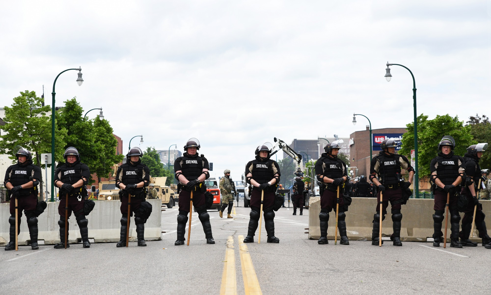 State Patrol officers and National Guard occupy East Lake Street on Friday, May 29.