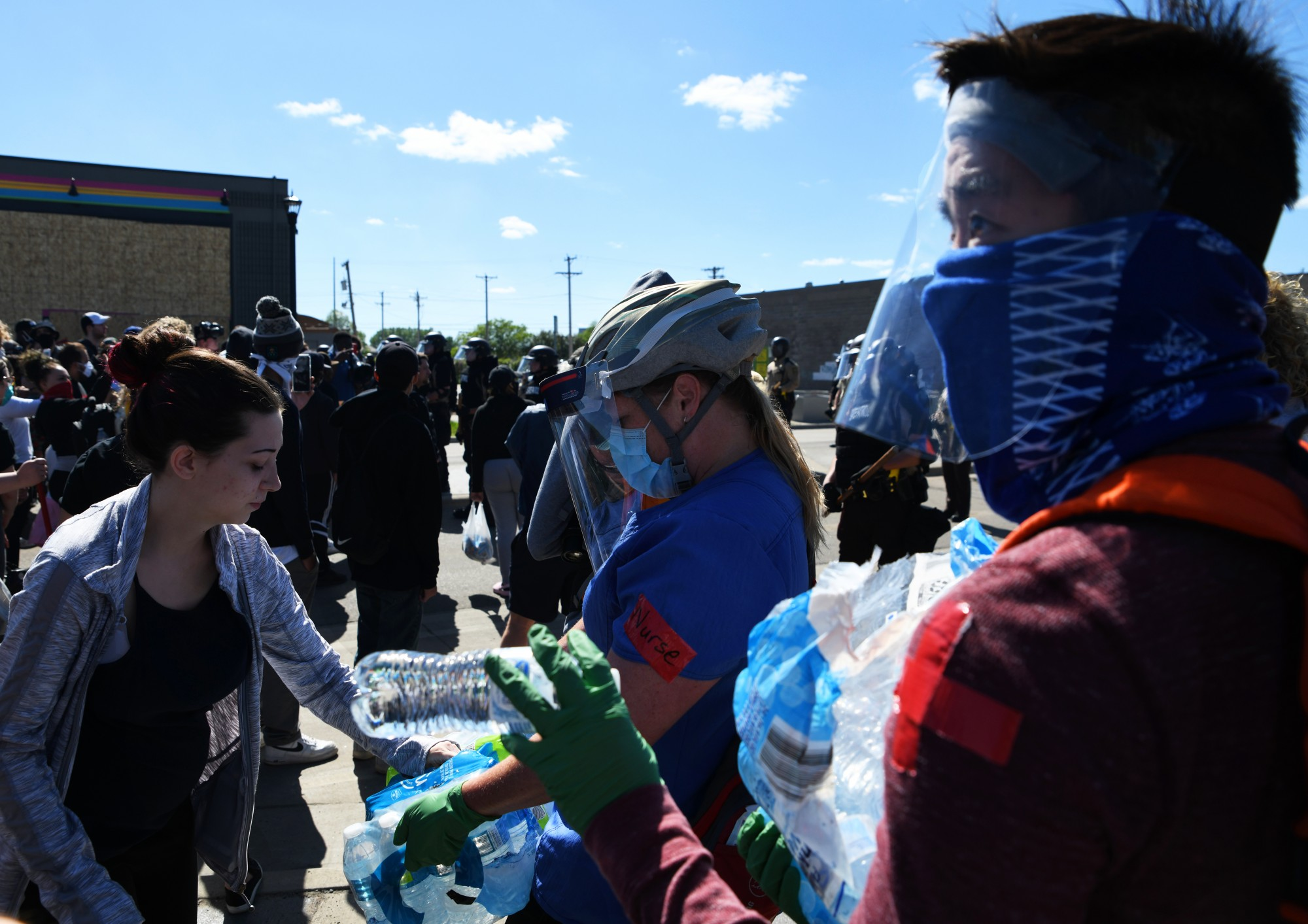 Volunteers hand out water to demonstrators near the MPD 3rd Precinct in Minneapolis on Friday, May 29.