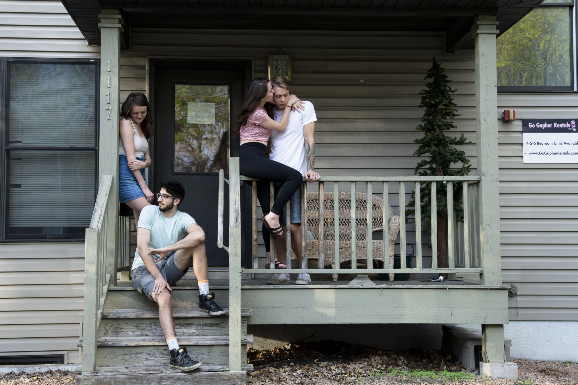 7:15 p.m. From left, Liz Wippler, Ben Javidan, Holland Griffin and Josiah Goodman pose for a portrait outside their home.