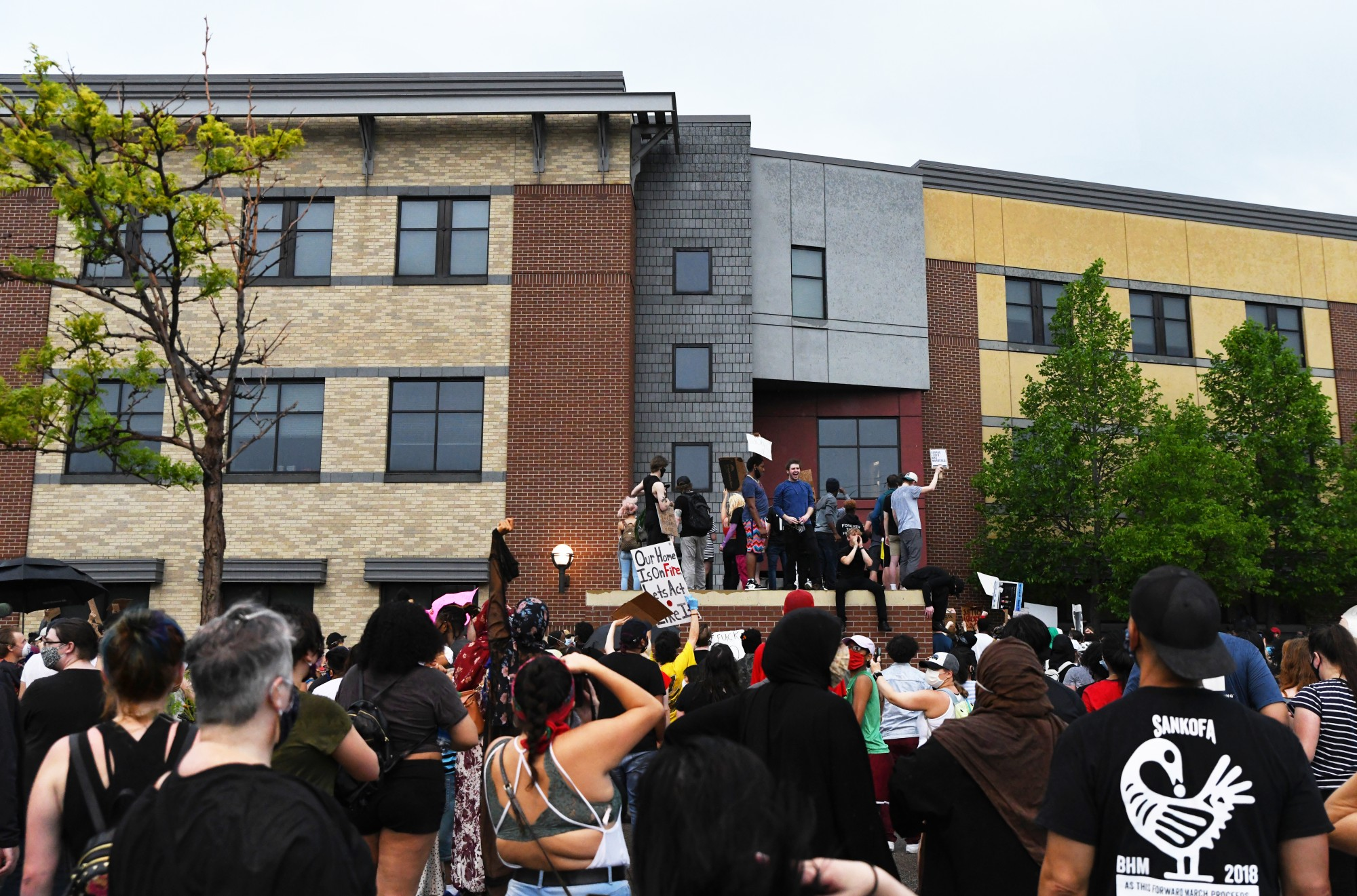 Demonstrators congregate outside of the Minneapolis 3rd Police Precinct on Tuesday, May 26.
