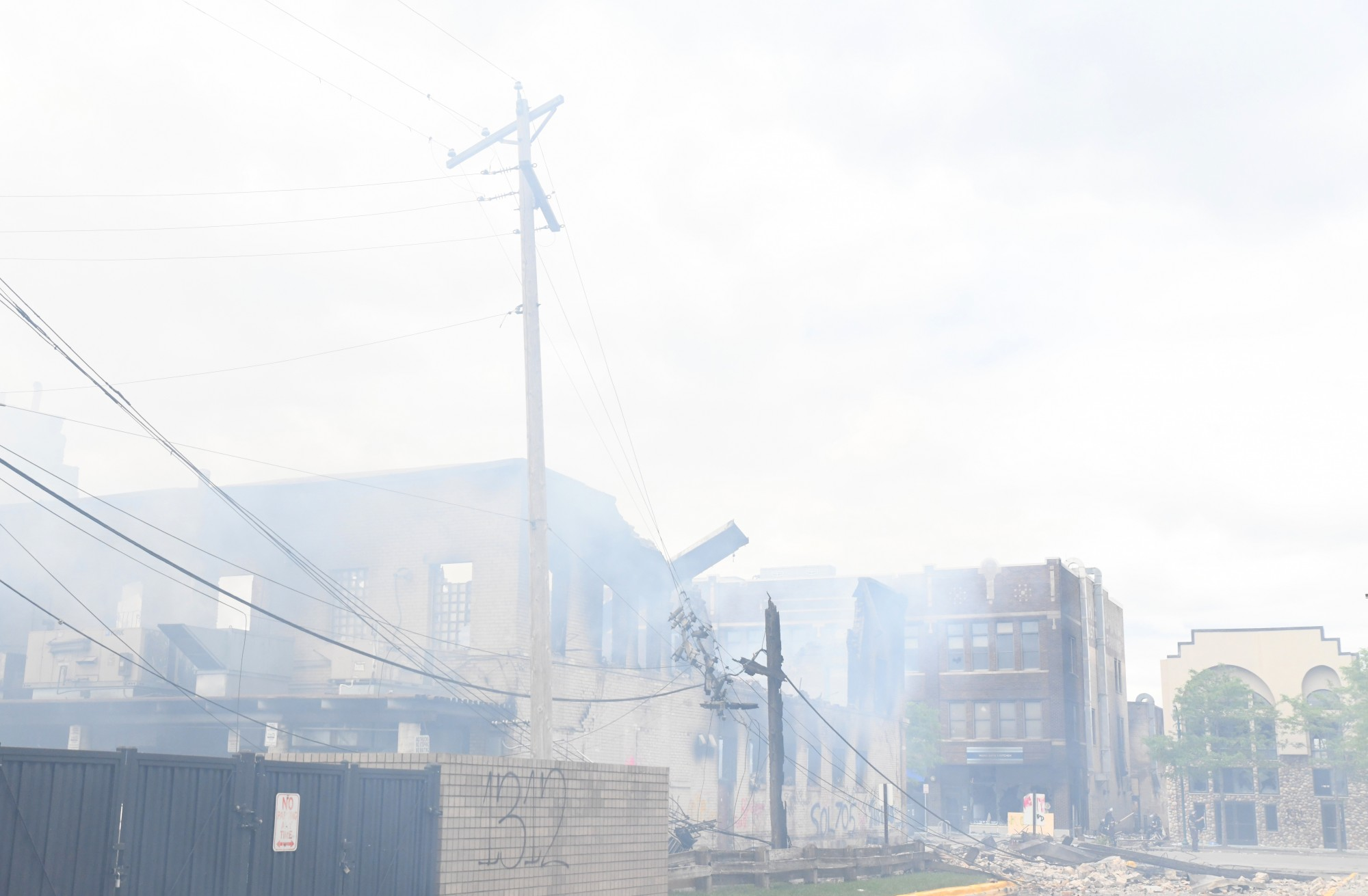 Smoke heavily obscures visibility as buildings continue to burn near the Minneapolis 3rd Police Precinct on Friday, May 29.