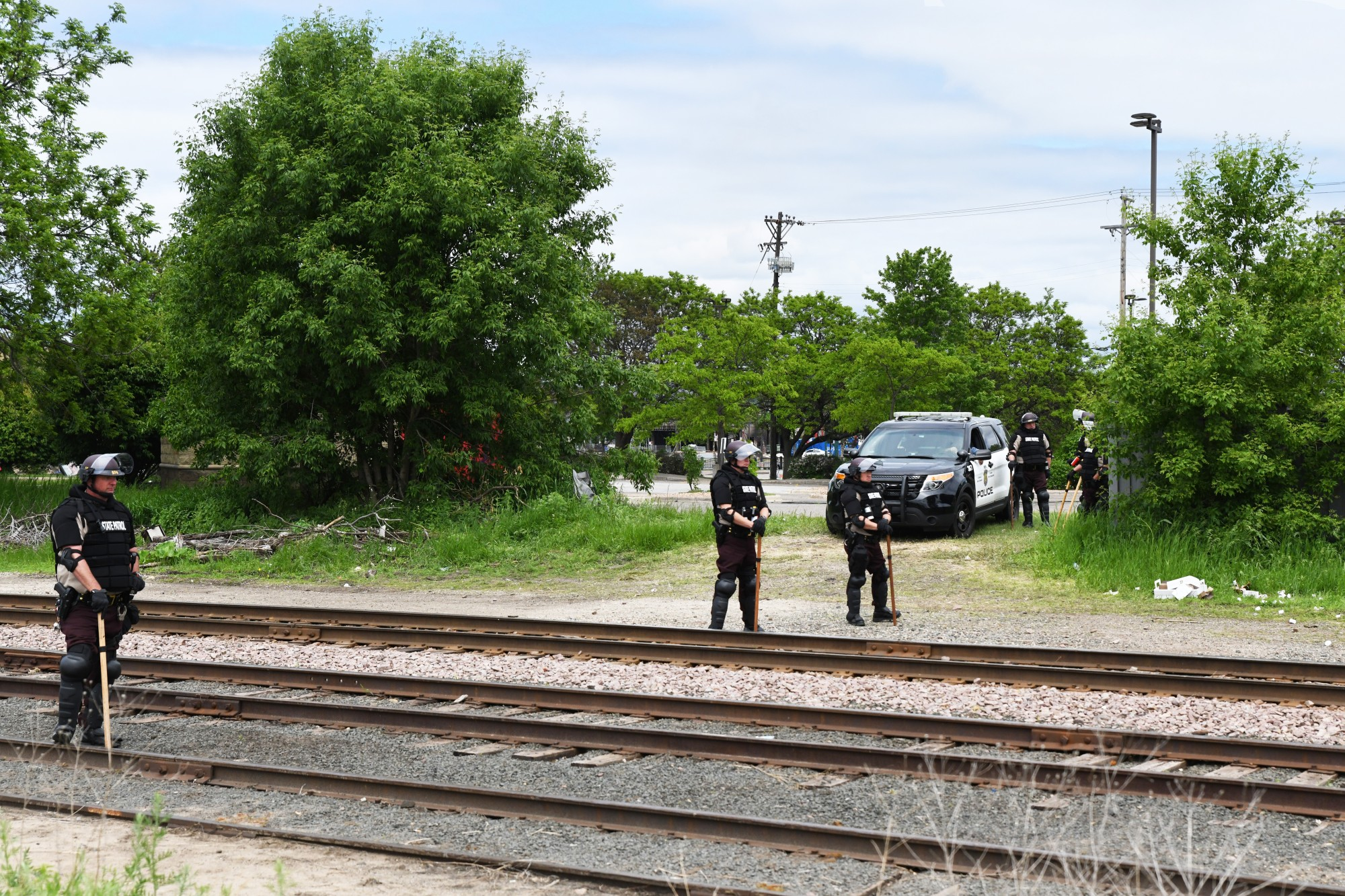 State troopers guard the railroad tracks that demonstrators crossed Tuesday to reach the Minneapolis 3rd Police Precinct on Friday, May 29.