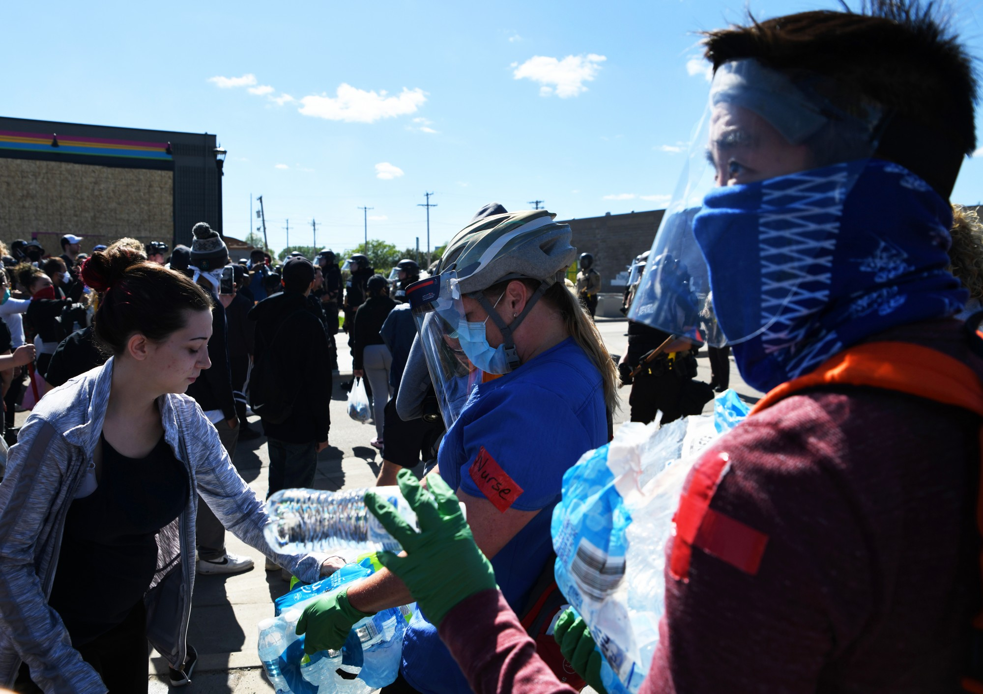 Volunteers hand out water to demonstrators near the Minneapolis 3rd Police Precinct on Friday, May 29.