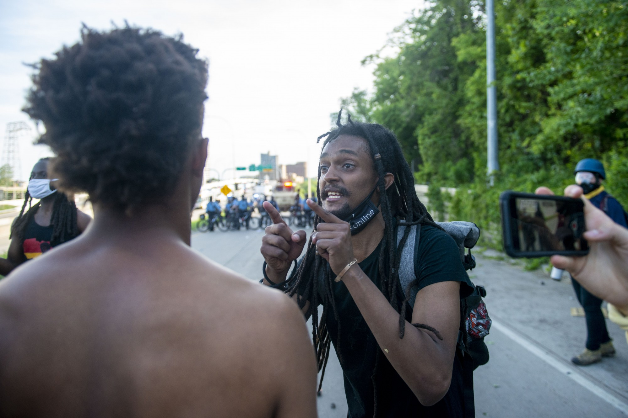 Protesters face down police at the intersection of 35W and University Avenue on Sunday, May 31.