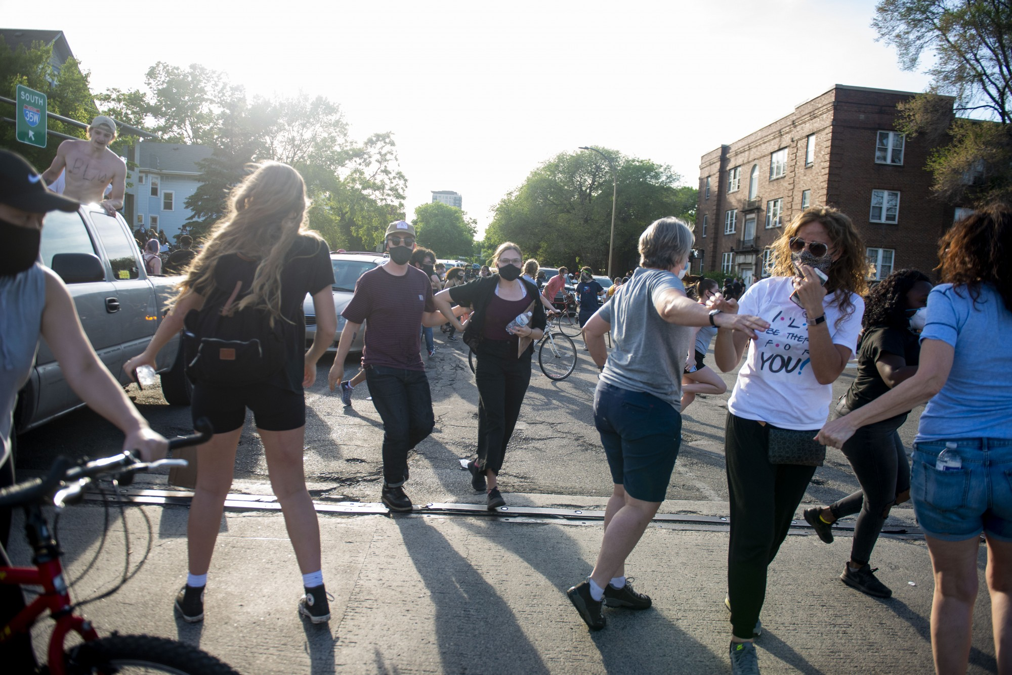 Protesters scatter following police use of tear gas at the intersection of 35W and University Avenue on Sunday, May 31.