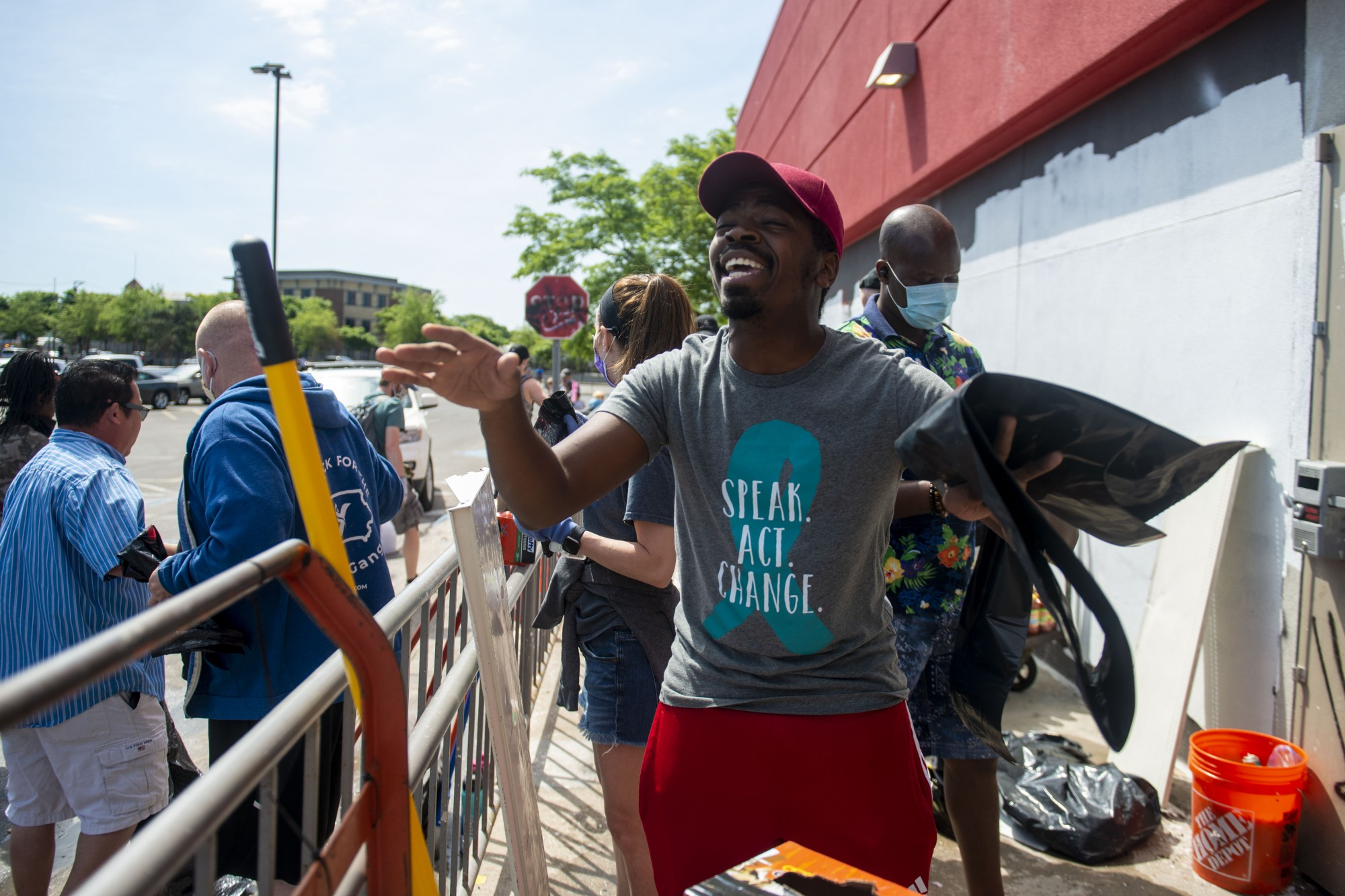 Pierre Paul, who drove to Minneapolis from Illinois, helps lead volunteers to clean up Target on Sunday, May 31. The goods were then donated to local non-profits and churches.