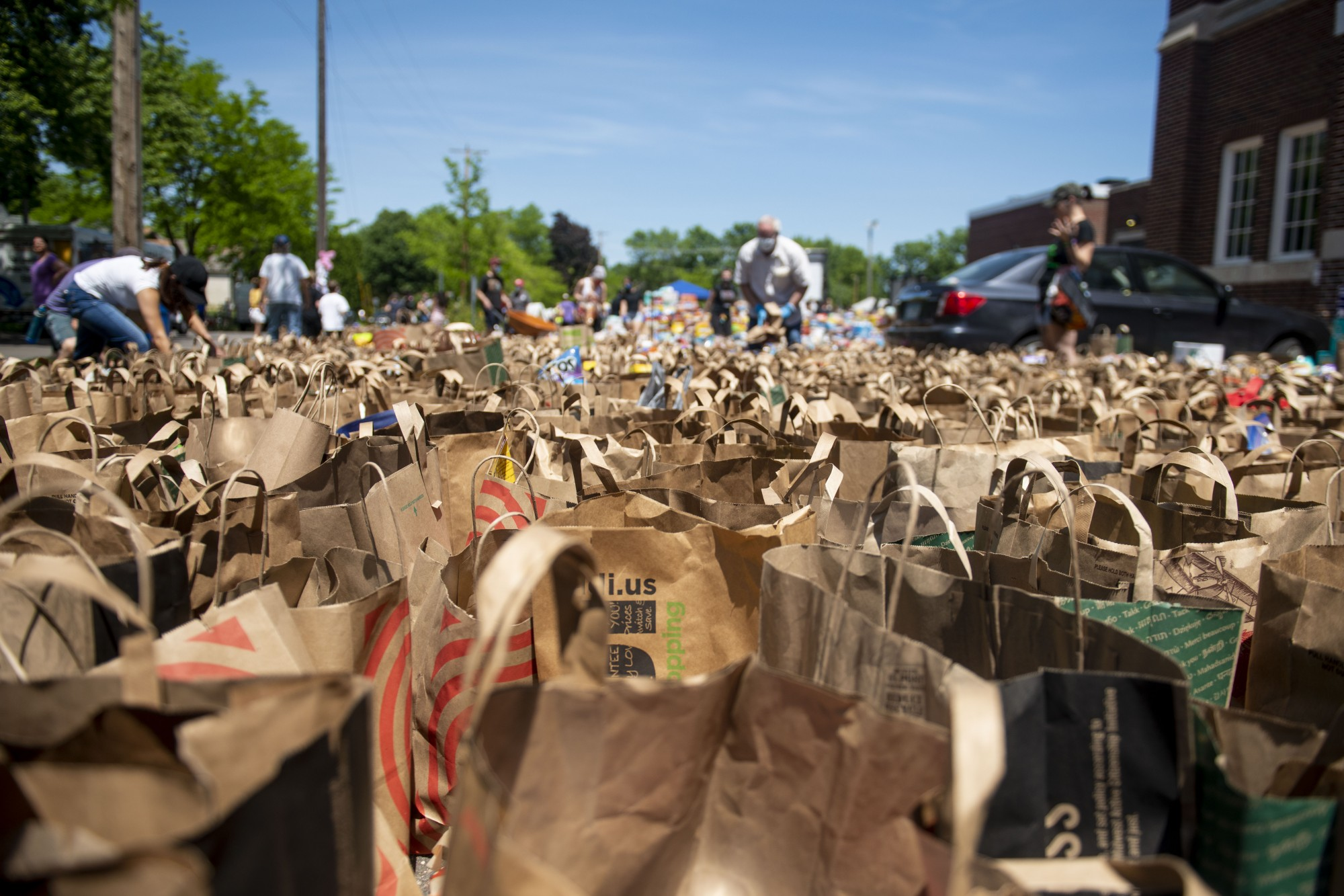 Donated goods are stockpiled and organized outside of Sanford Middle School in Minneapolis on Sunday, May 31.