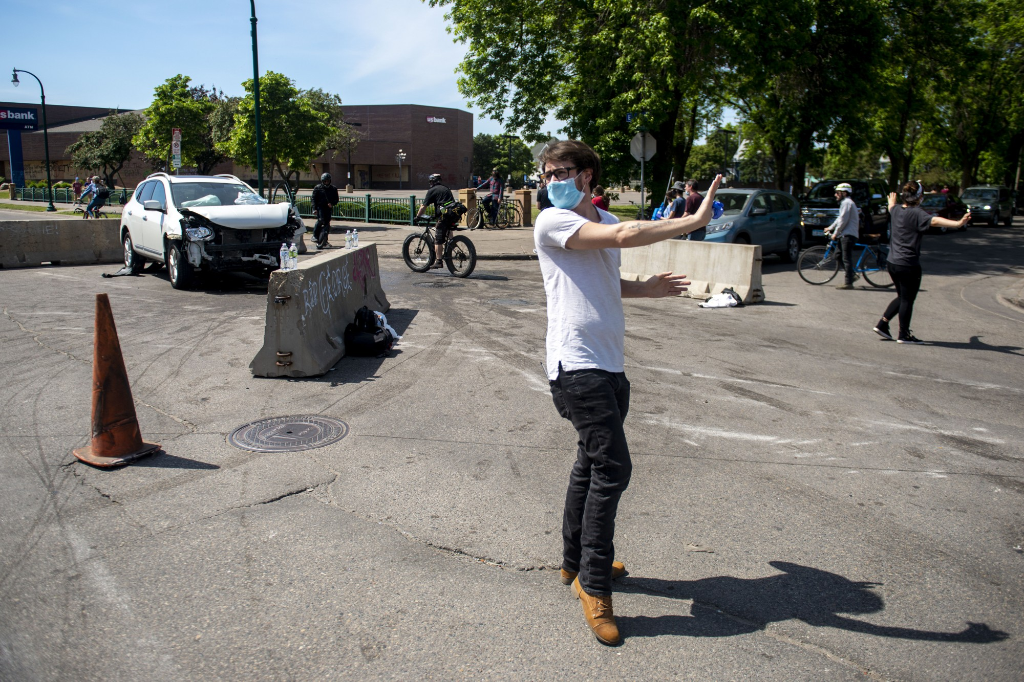 Zeke Scott helps to redirect traffic on Lake Street after an accident on Sunday, May 31.