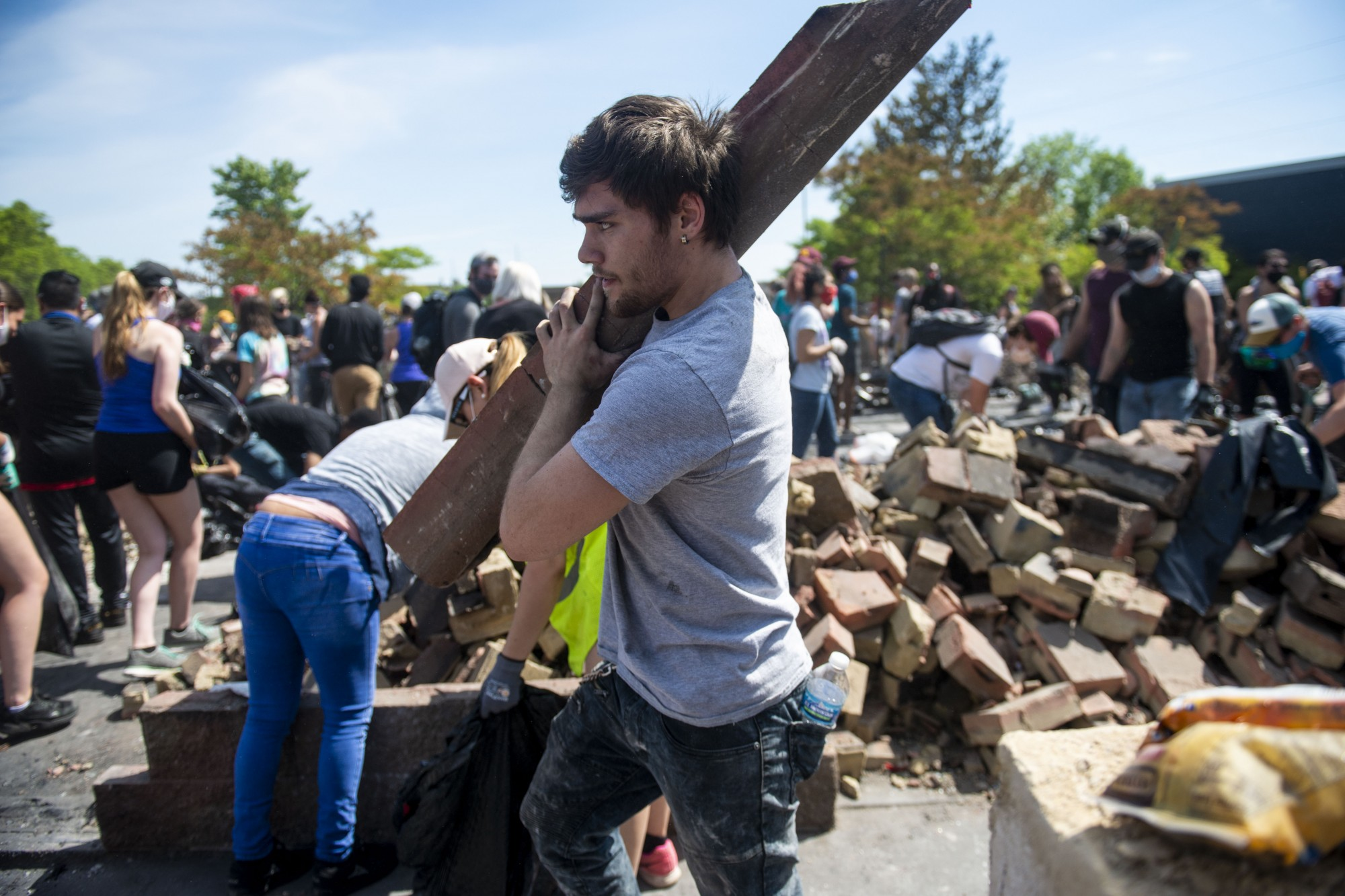 Volunteers help to clean up debris at an Arby's that was destroyed as part of riots on Lake Street in Minneapolis.
