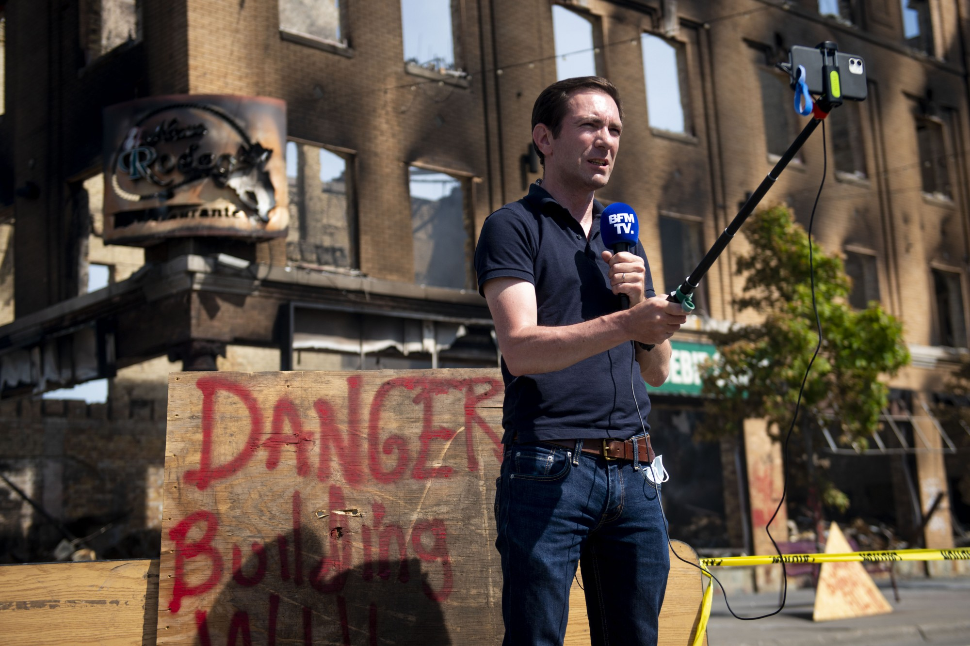 Cédric Faiche, a correspondent for the French station BFM TV, records himself on Lake Street in Minneapolis on Sunday, May 31.