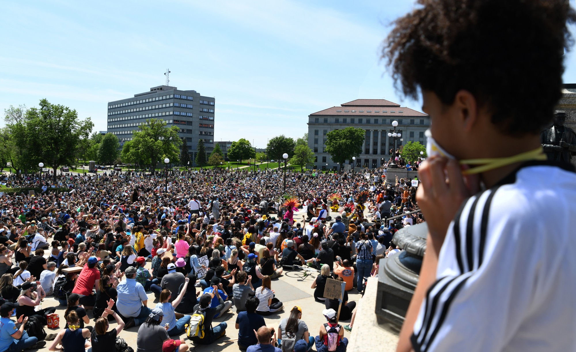 """""""Markus,"""" a 13-year-old from Cottage Grove, watches Yaocenoxtli, with Huitzillin and Mexica Yolotl supporting, give a presentation at the Minnesota State Capitol on Sunday, May 31. """"There are a lot of people,"""" Markus said. """"I didn't know it would be this much."""""""
