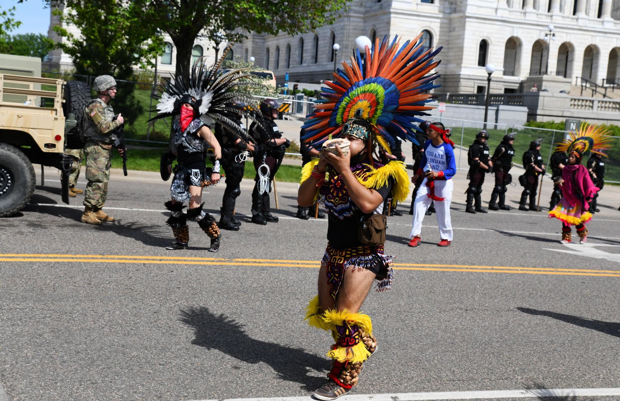 Yaocenoxtli, Huitzillin and Mexica Yolotl members lead demonstrators toward I-94 from the Minnesota State Capitol in St. Paul on Sunday, May 31.